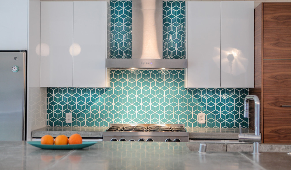 Fireclay designer tile, concrete counters, Semihandmade cabinets, Grohe faucet, and IKEA cabinets were used in this mid-century modern Eichler.
