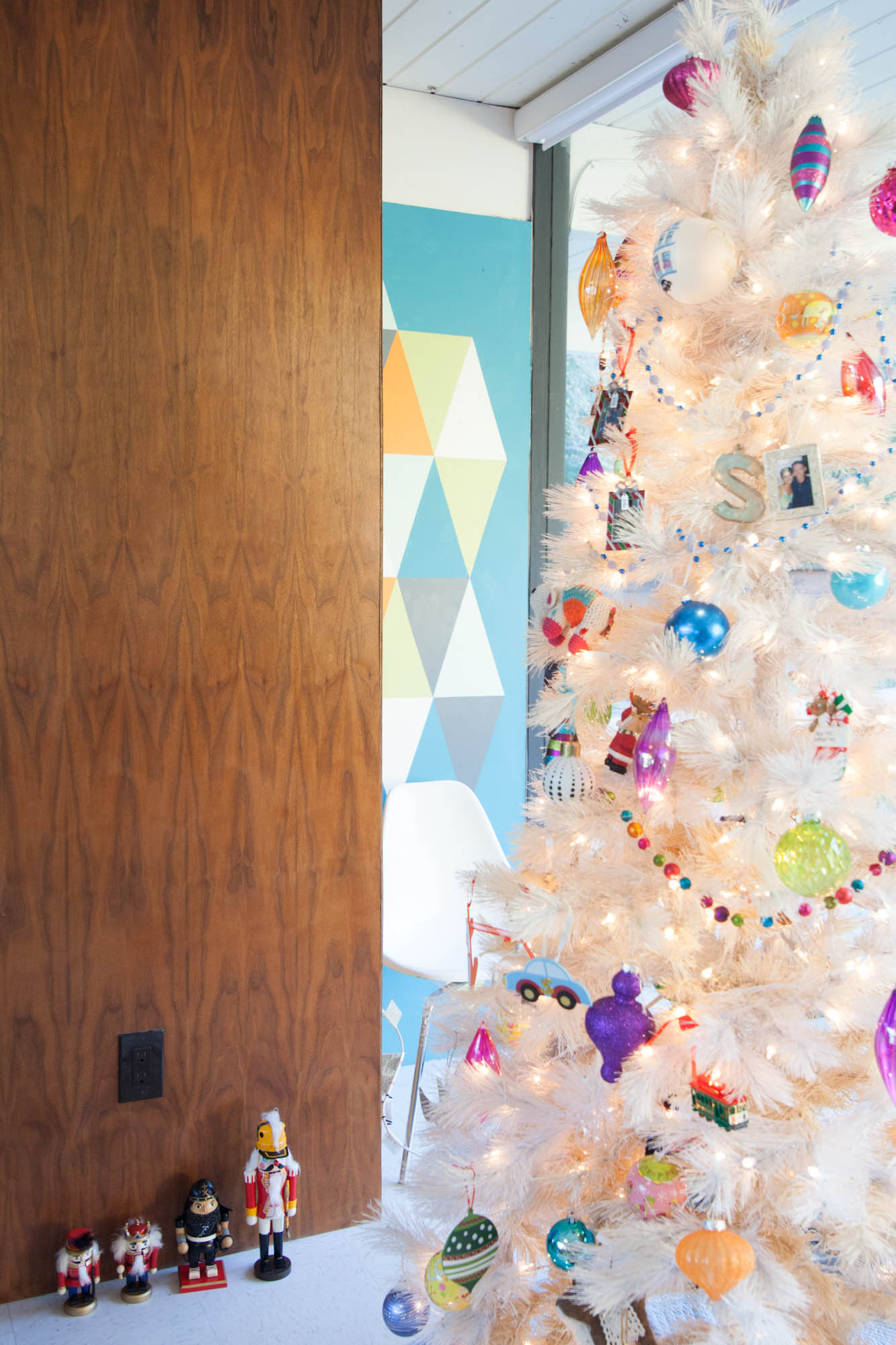 Our mid-century modern white Christmas tree and the kids' growing Nutcracker collection.