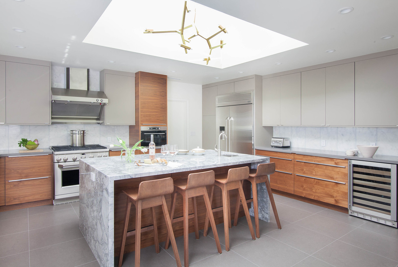 The original Kitchen footprint was already very expansive and offered a lot of storage. We kept to mostly the same layout, adding a center Island for prep and dining;the clients were also super smart to add a secondary sink and install dual dishwashers. (Dreamy!)
