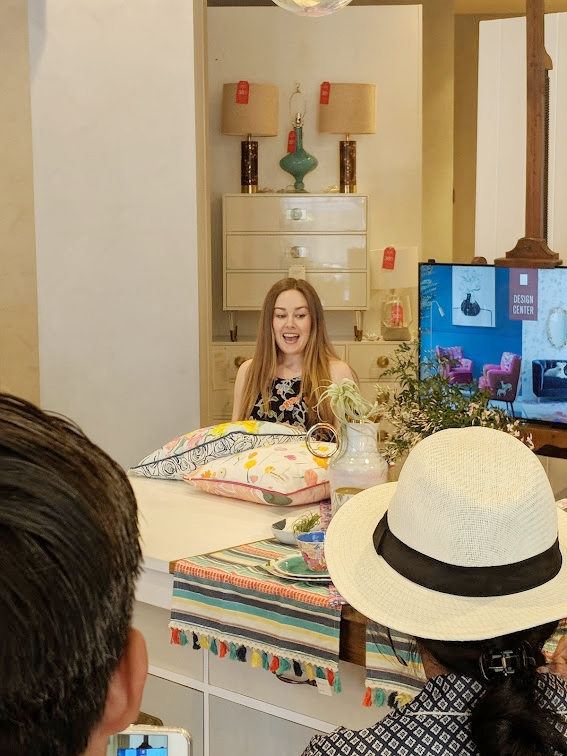 The very talented and sweet Bridgette, showing her designs featured on tabletop and pillow collections.