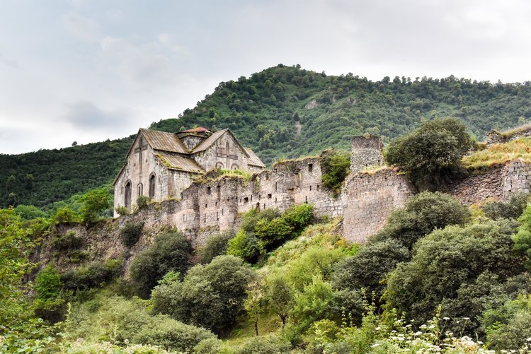 The fortress and monastery of Akhtala is located in Lori province, along the Shamlugh River, on the slopes of Lalvar Mountain