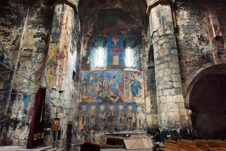 Unrestored frescoes in the sanctuary