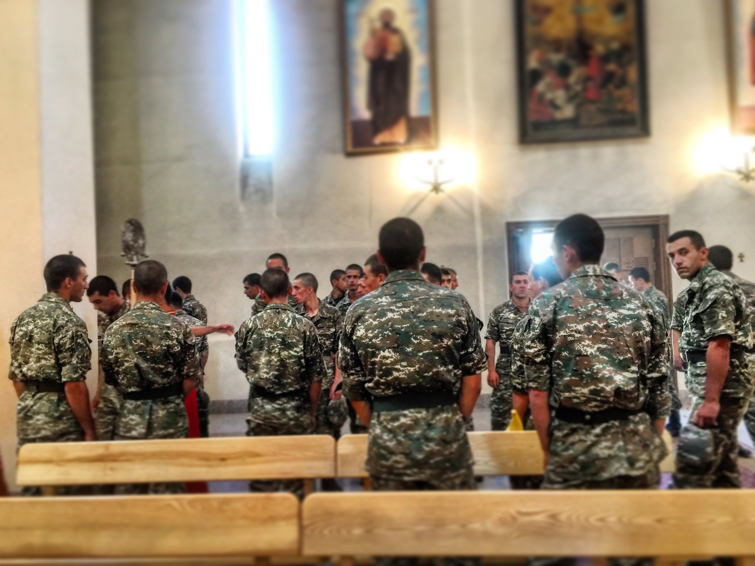 Soldiers from the posts protecting Armenia from Azerbaijani border violations wait for blessings