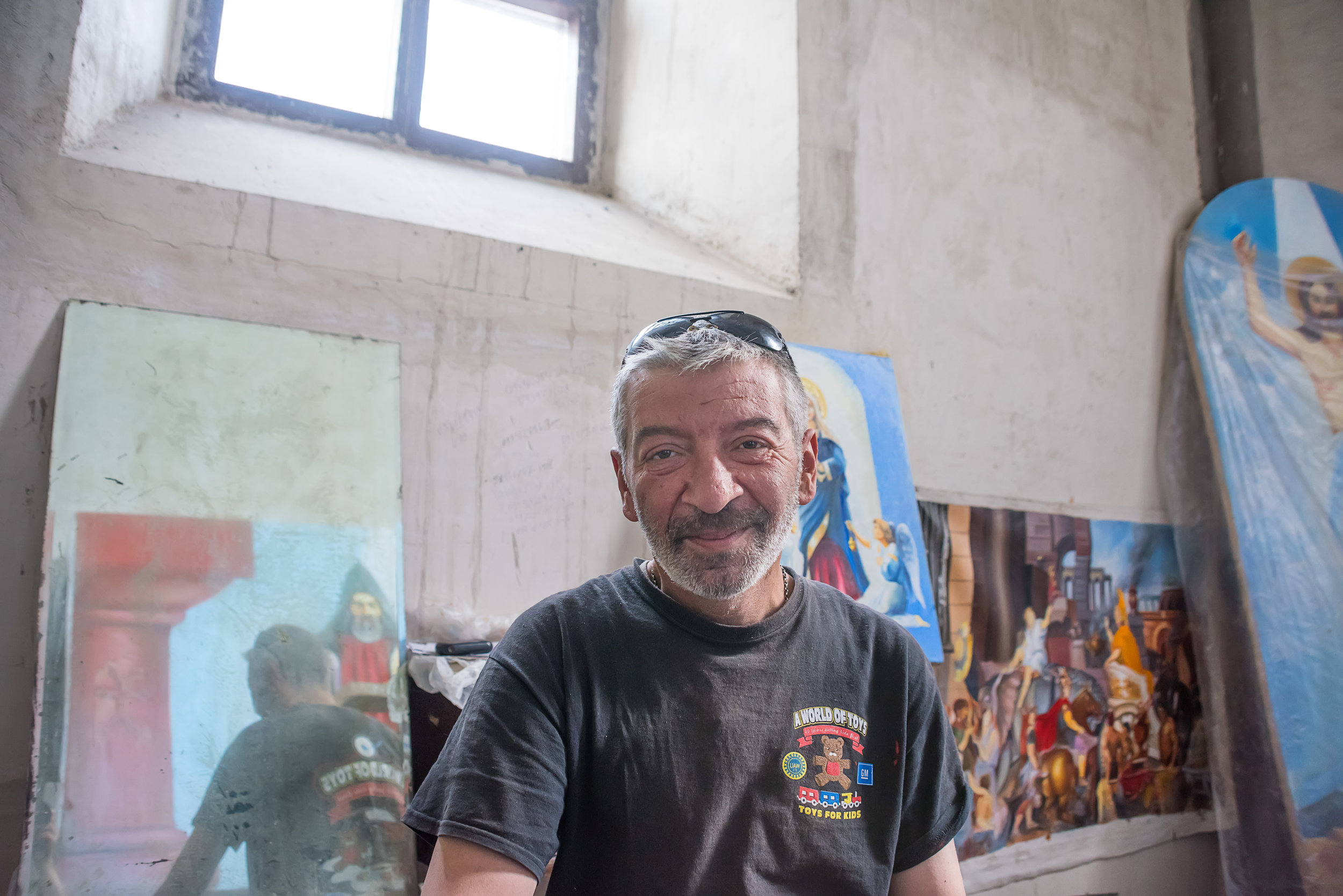Tigran, the painter whose work will grace the cathedral interior, in his studio