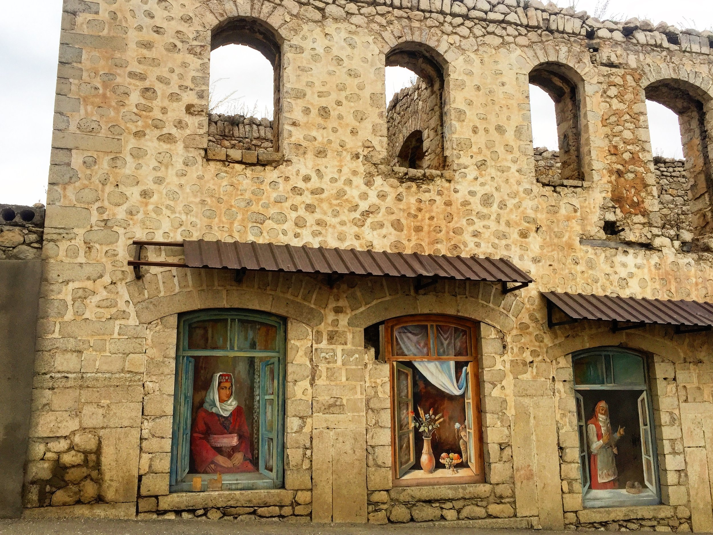 Building damaged in the war for independence holds murals of traditional life while awaiting restoration