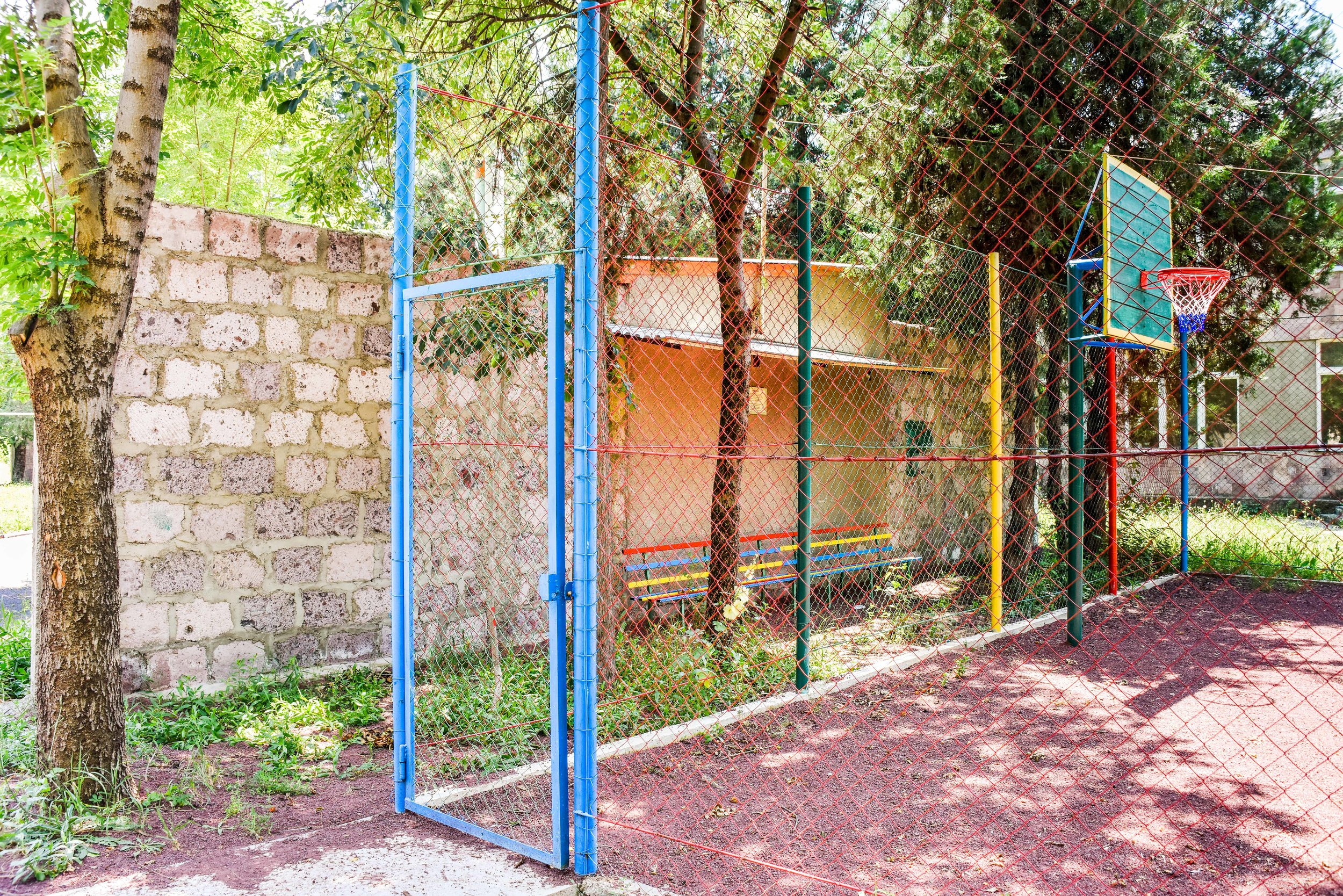 Wall encircling the playground to protect it from gunfire, such as Ayo! has helped provide to villages needing safe spaces for children.