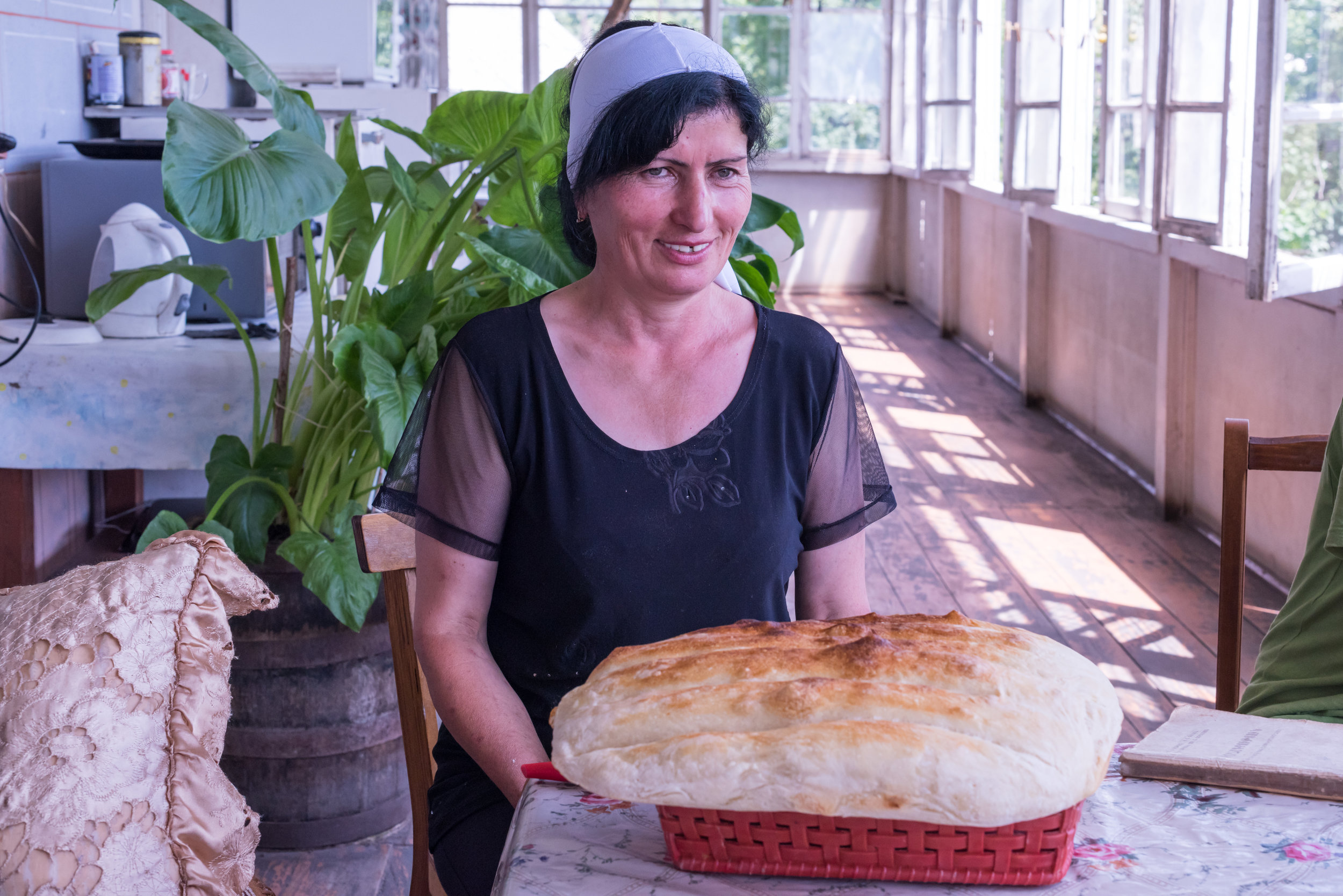 Narine with her amazing homebaked matnakash bread, where FAR has helped update her home in Navur to provide a healthy environment for her family.