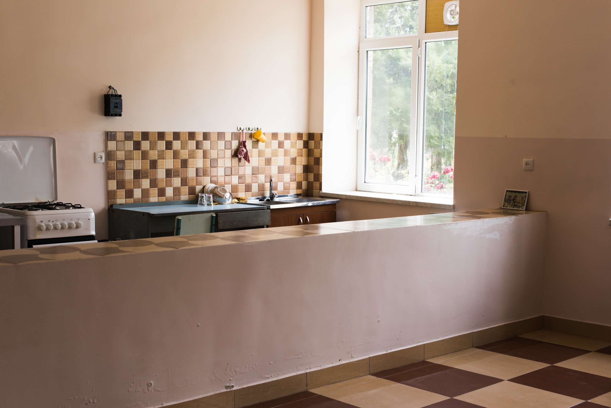 FAR restored the kitchen in Choratan's elementary school, where children can now enjoy nutritious meals.