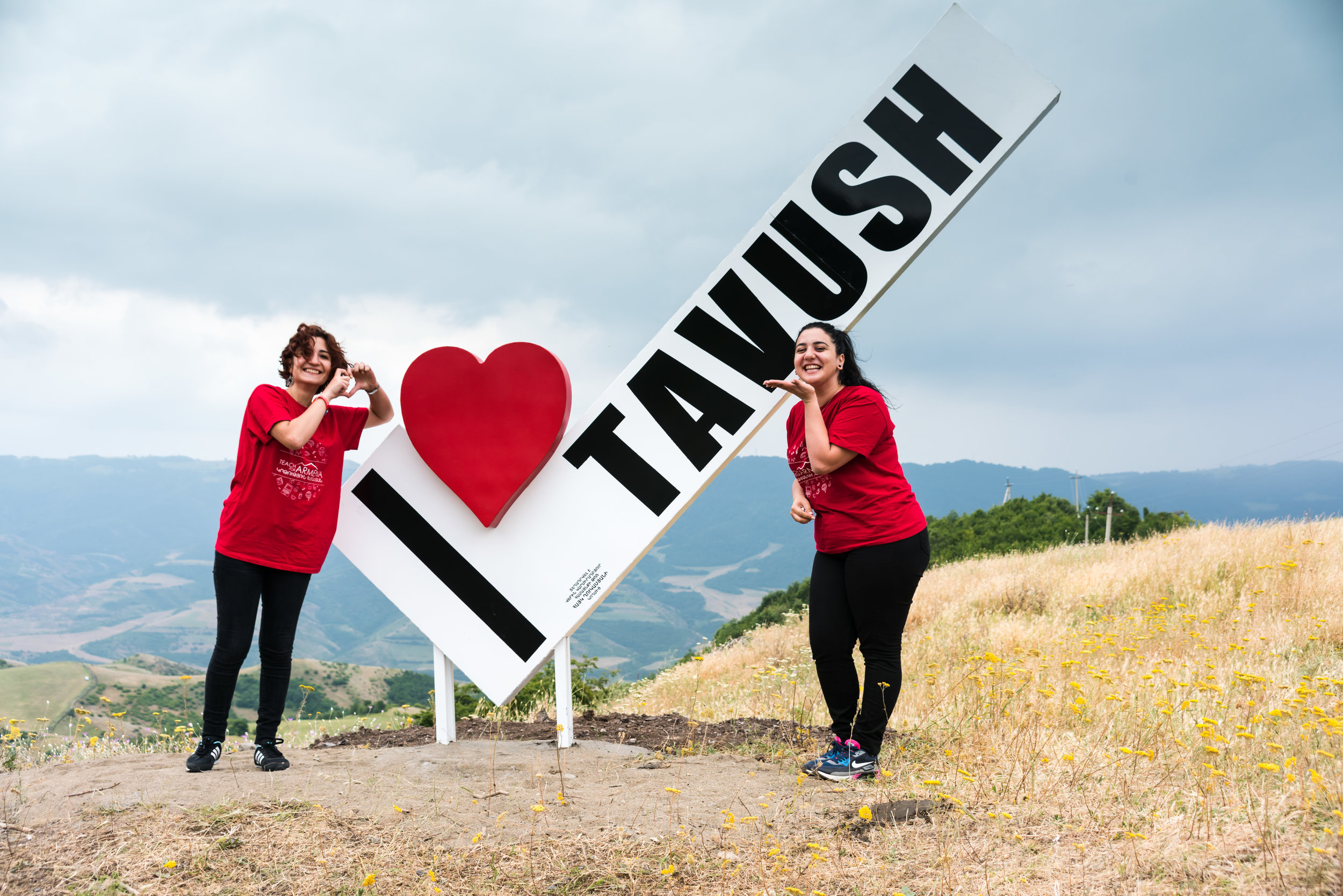 Margarita (left) and Arsholuys (right) by the newly installed I Love Tavush sign