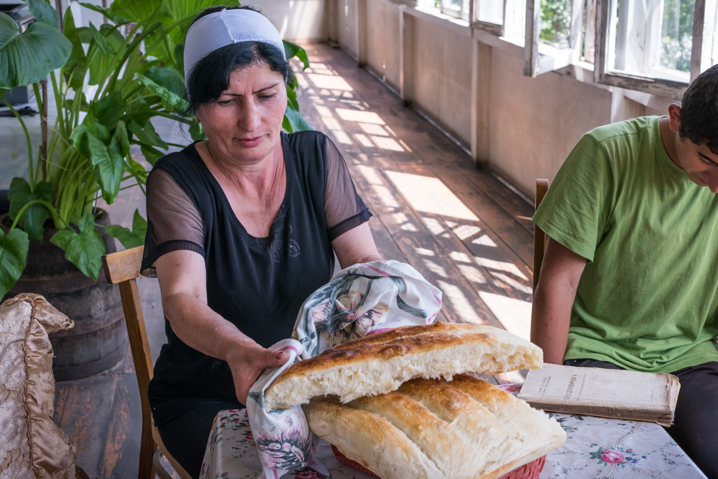 Narine offers us her fresh matnakash, in Navur, Armenia.  Her family has been helped by FAR, and now she can concentrate on her children's education.