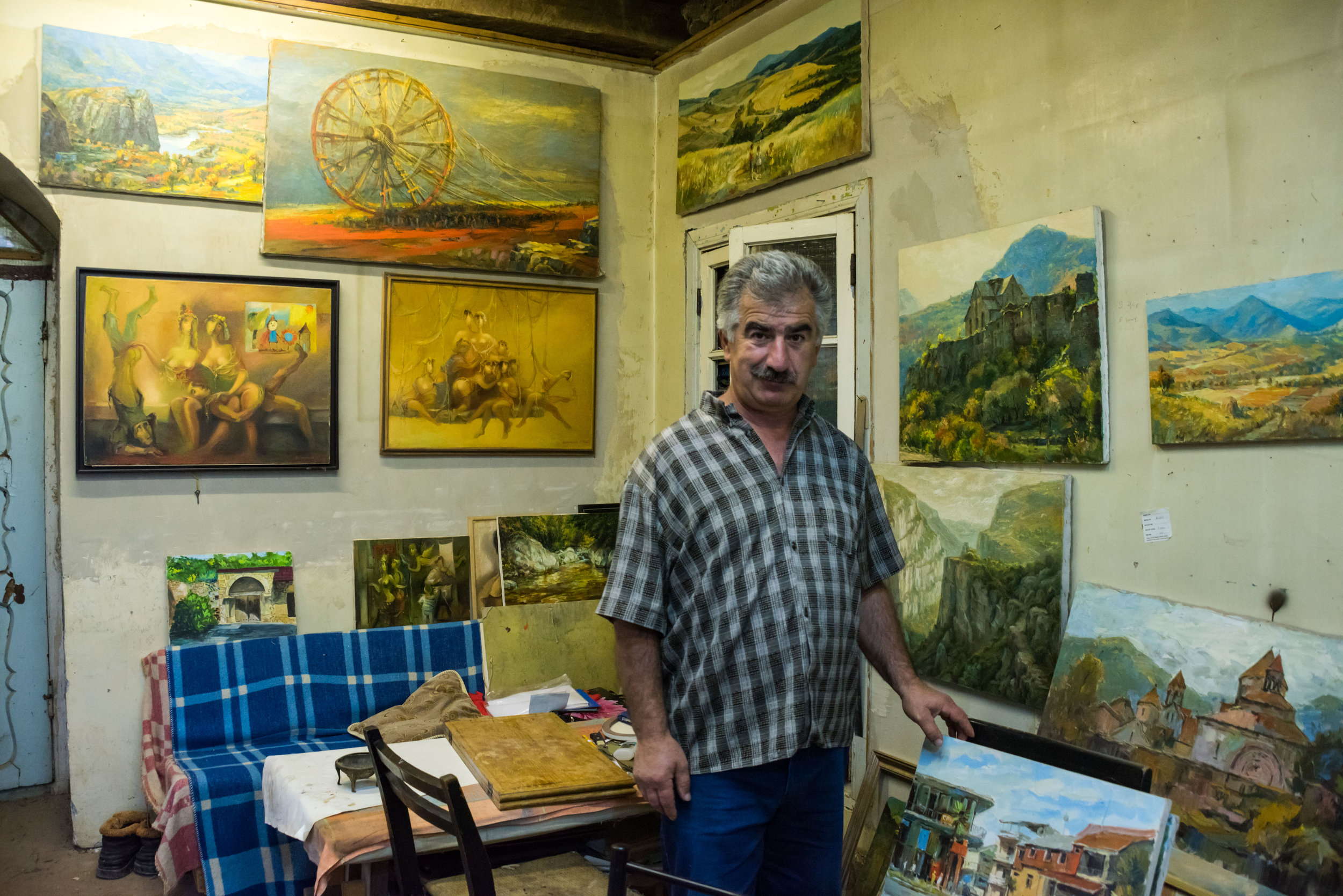 Painter Hovik Gasparyan in his Shushi studio.  His landscapes capture the soul of the Armenian lands, while his modernist work is rich with social and political commentary.