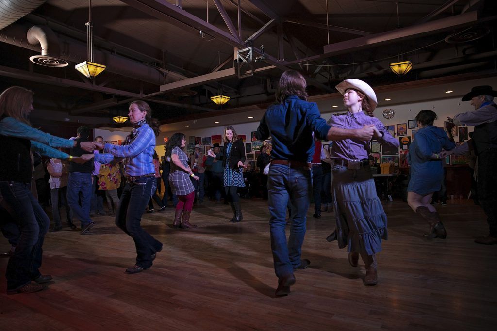 The  National Cowboy Poetry Gathering  wraps with a spirited dance starting at midnight and lasting until the early hours of the morning. Photo by Liz Beddall.
