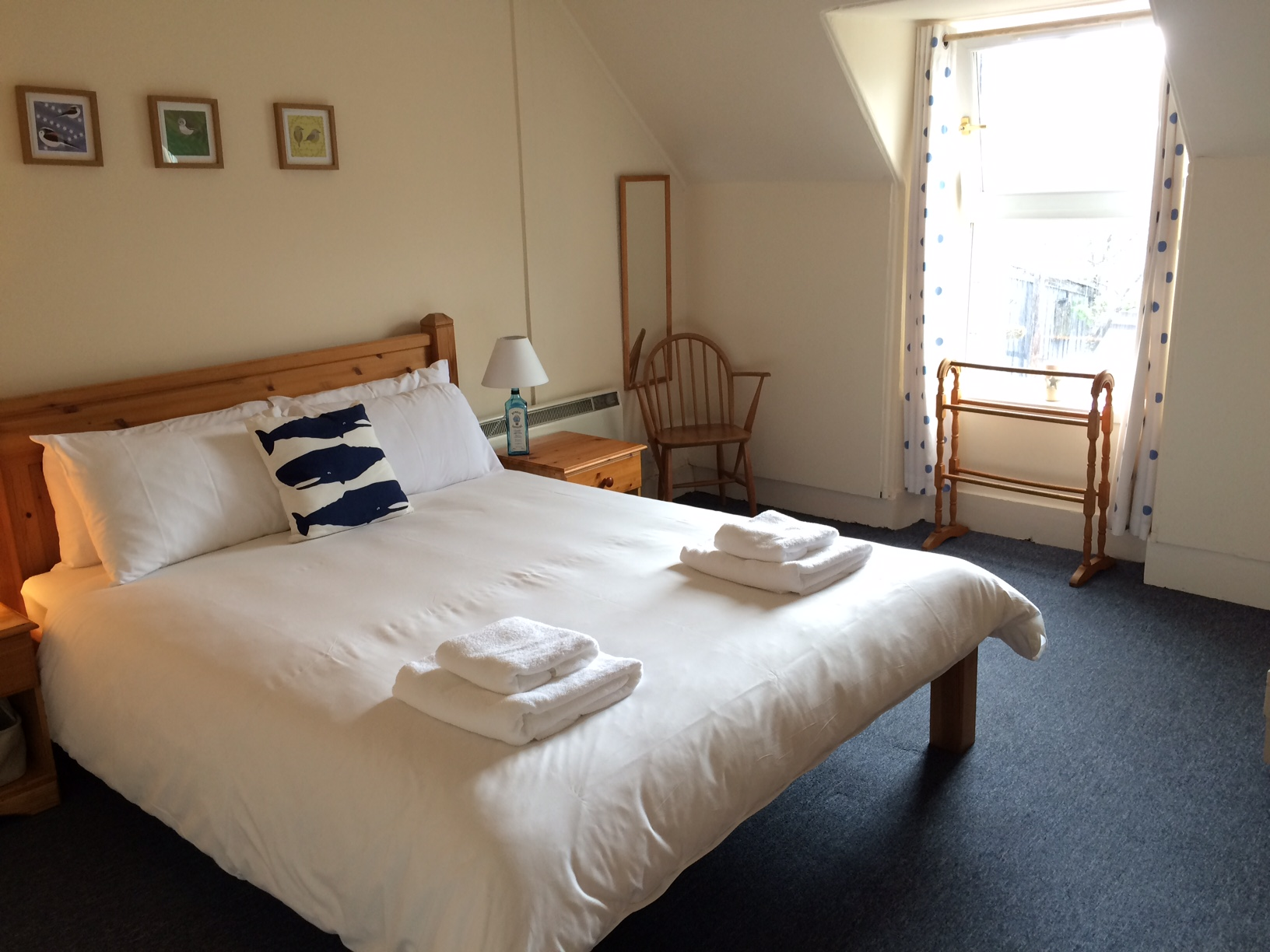 King size bed in bright spacious room