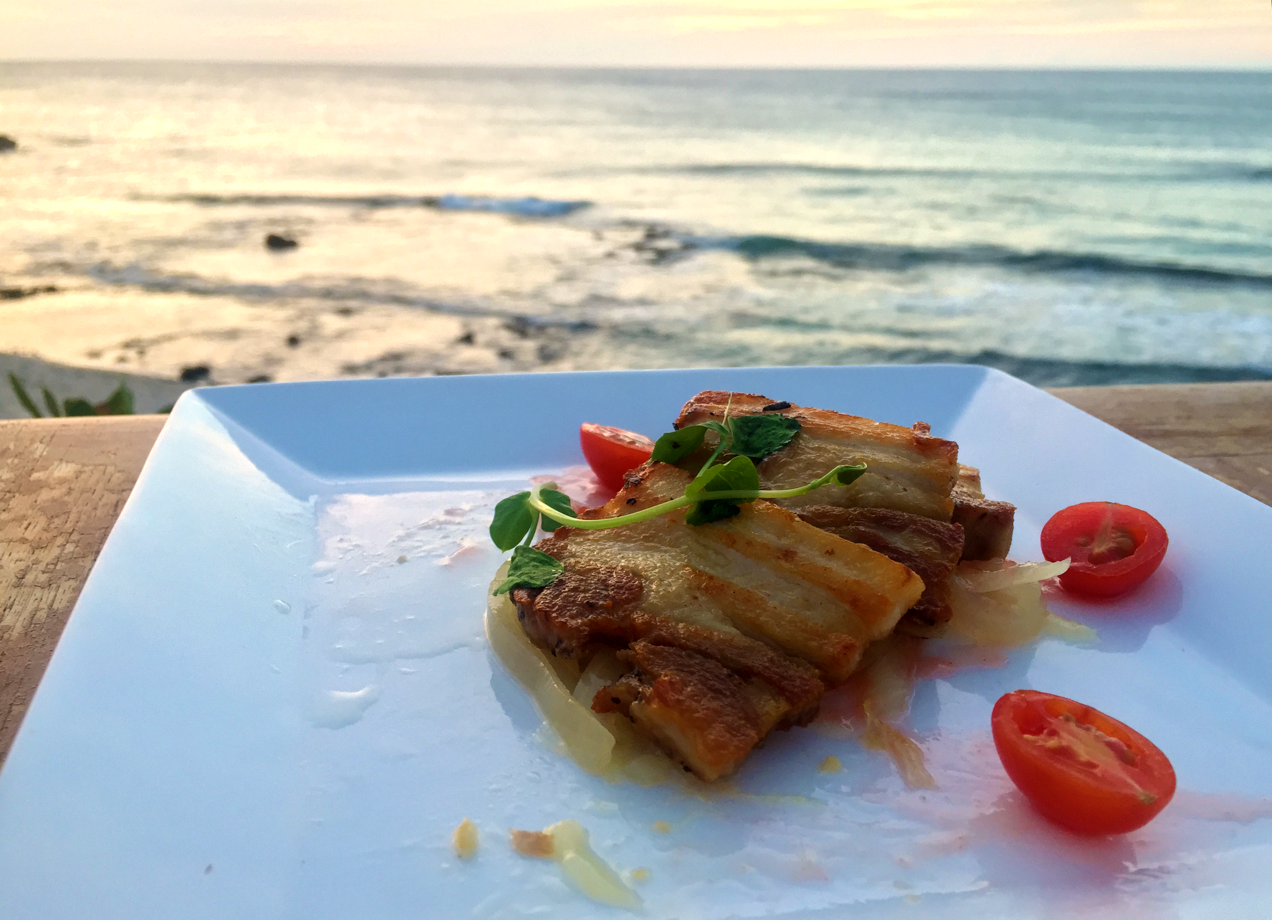 Tender Grilled Pork Belly overlooking the sunset at  Kamuela Provision Company