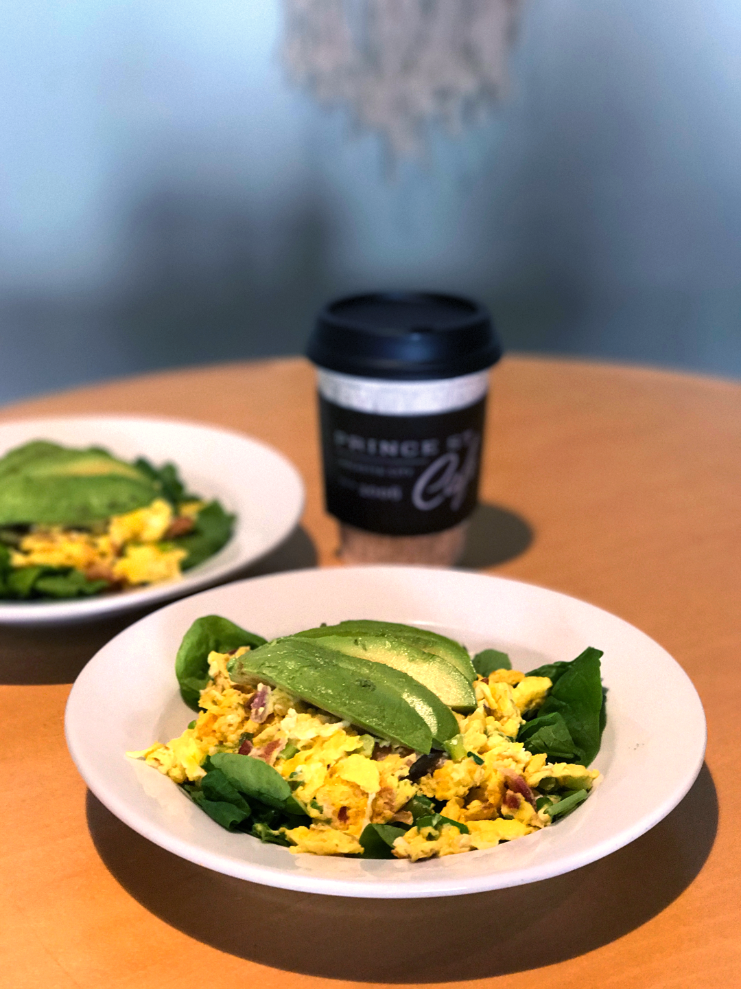 Seasonal Scramble from Prince St. Cafe. Scrambled eggs with bacon, scallions, and avocado on a bed of spinach. So good!