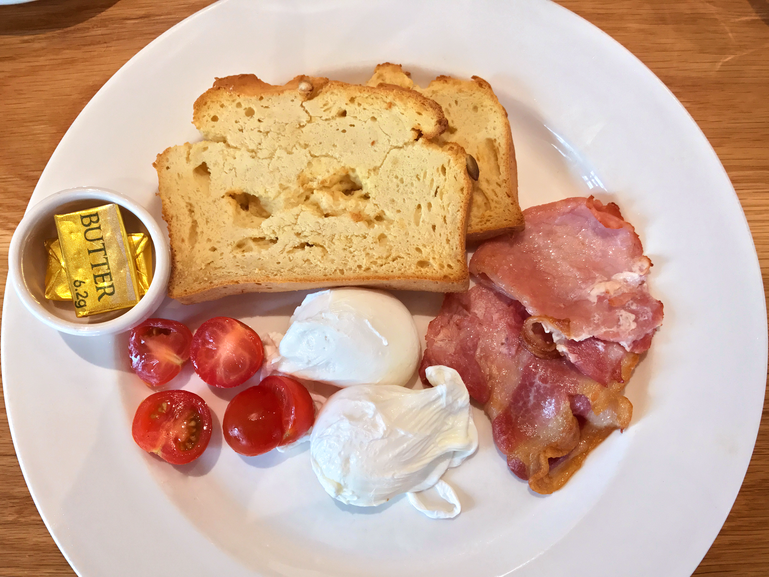 Poached eggs, bacon, and homemade gluten-free bread from   Loudons Cafe & Bakery