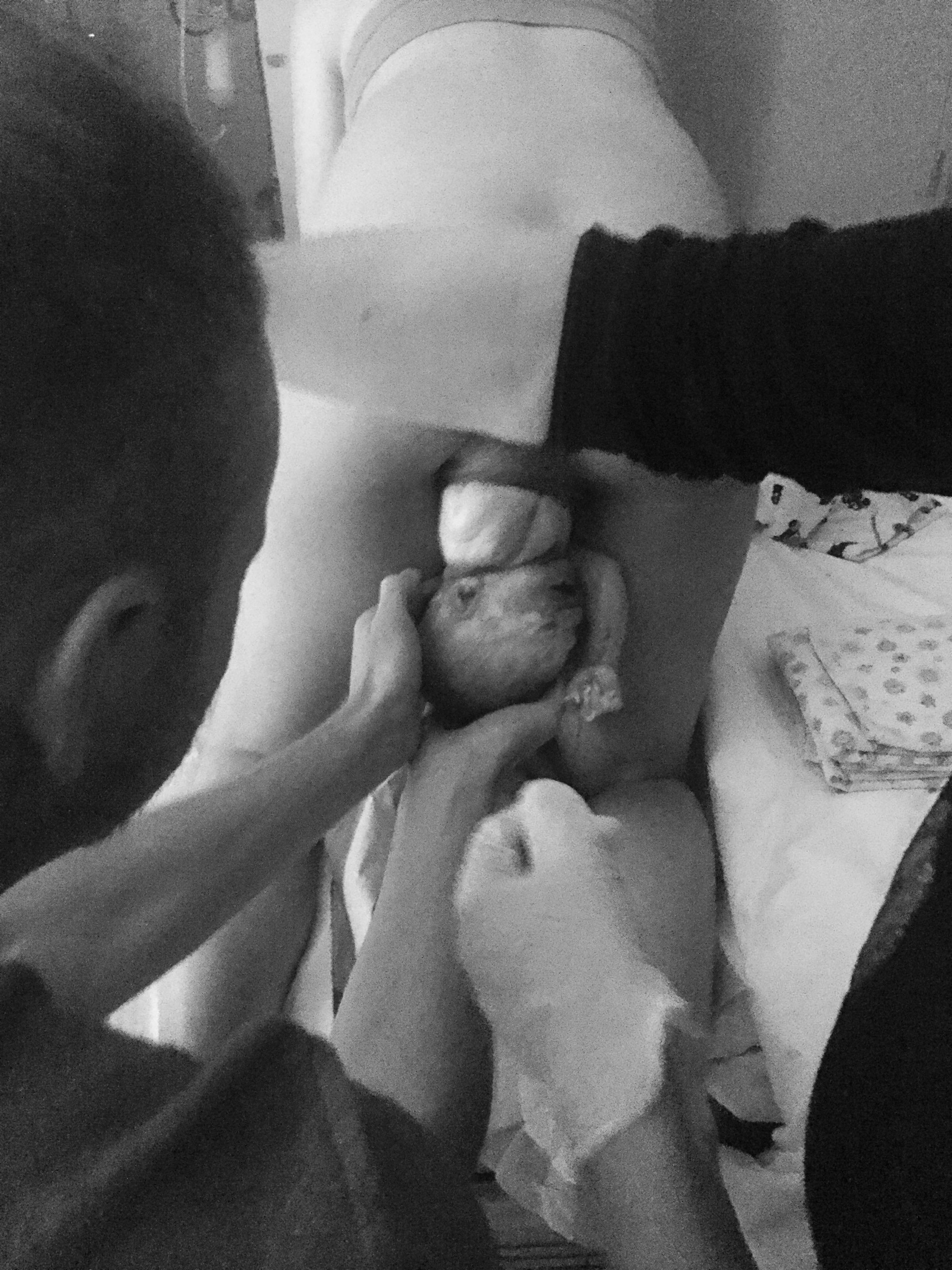Dad receiving baby