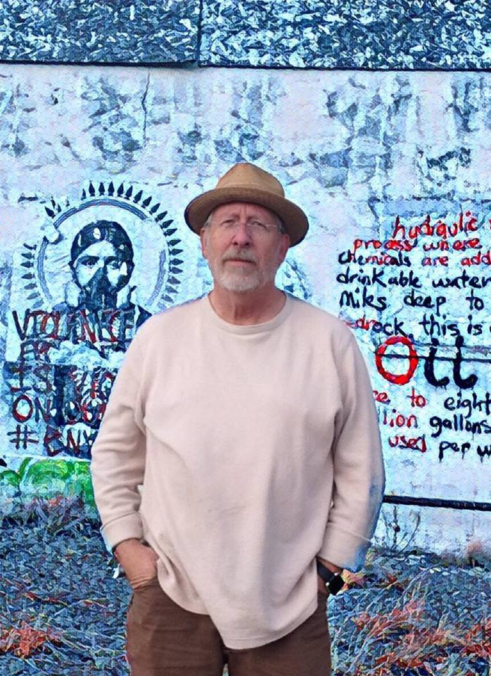 Rick Hatfield in front of artistic wall.jpg