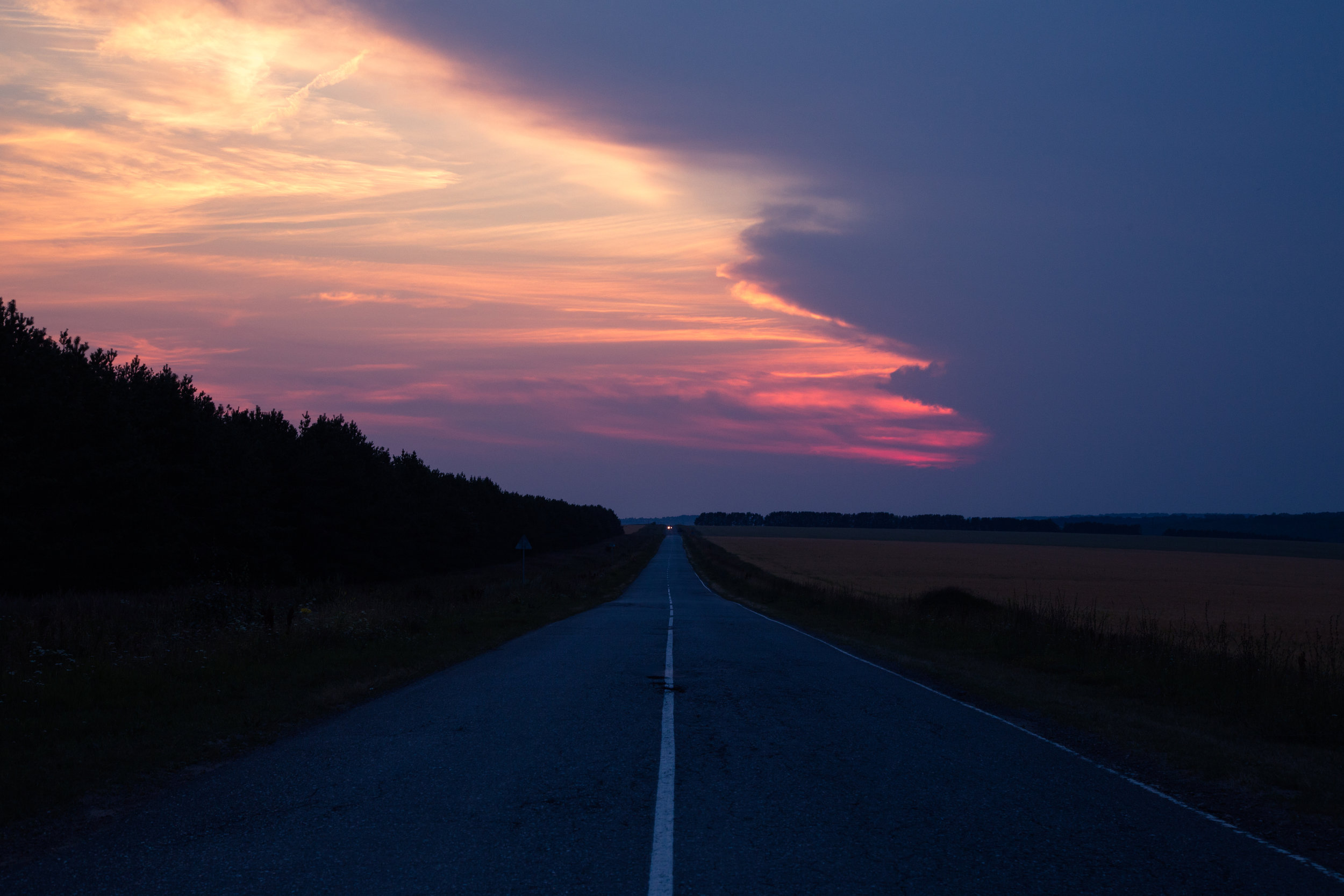 A sunset over a rural Russian road. This road leads to a bigger village nearby called Sovetskaya.