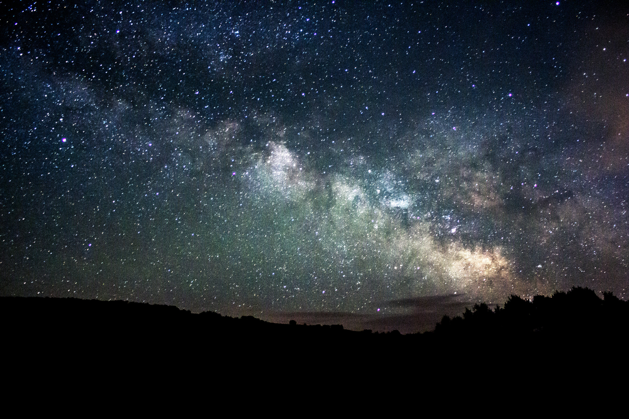 My first picture of the Milky Way. I shot this with a Canon T4i with a simple 18-55mm Kit lens. Aperture: f/3.5 Shutter: 20 seconds ISO: 1600