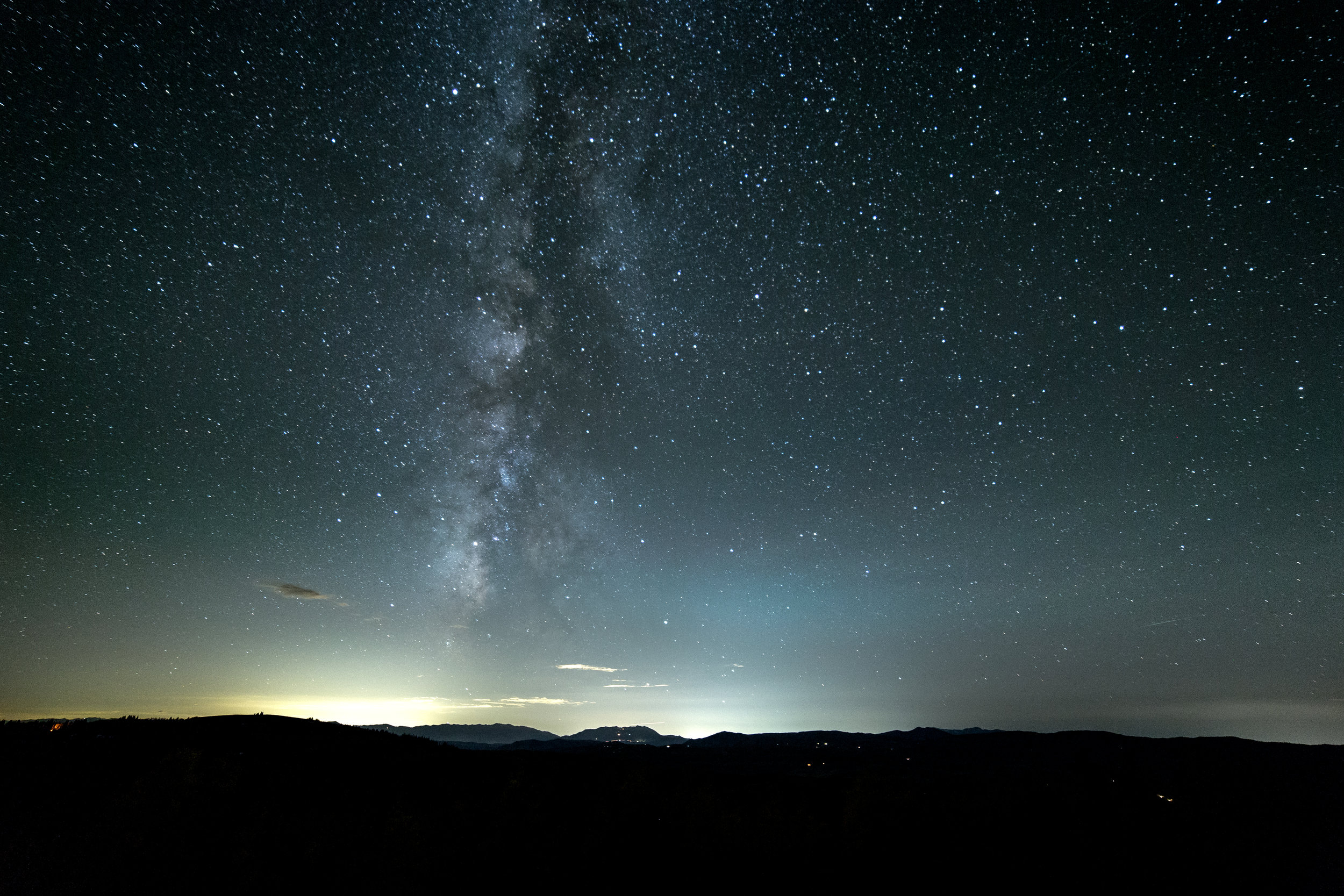 Milky Way rising over Ogden. Shot with 14mm Rokinon lens at f/2.8 Shutter Speed: 20 seconds ISO: 1600