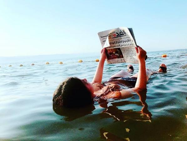 Relaxing in the Dead Sea. Photo taken by  @eldora0x0 on Instagram .