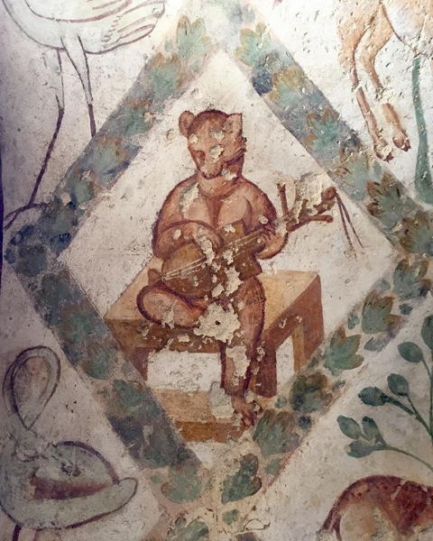 Animal playing a stringed instrument at Quseir Amra. Photo taken by Simon Bowden,  @sj_bowden on Instagram .