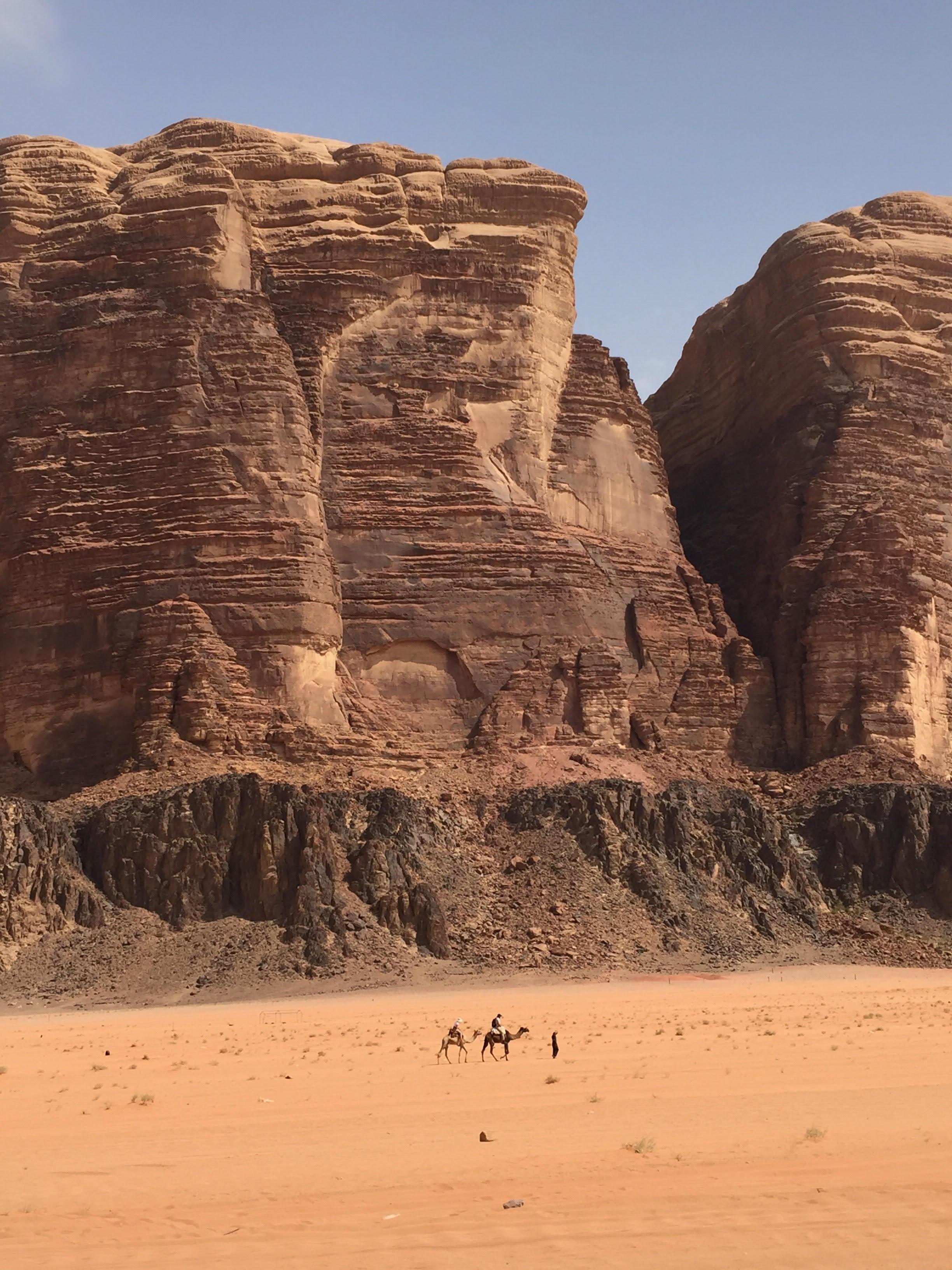 Travelling by Camel in the Wadi Rum Desert. Photo taken by Jurick Wessels,  @jurickwessels on Instagram .