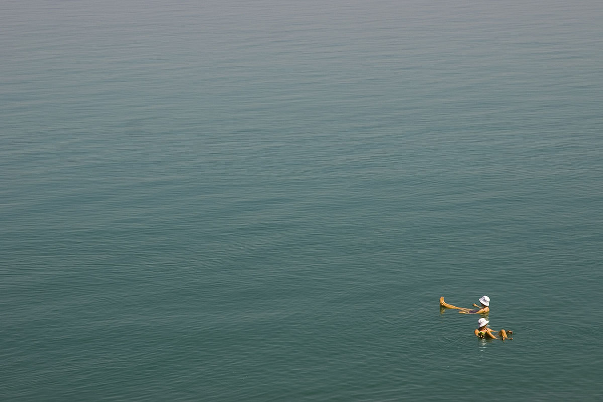 Floating in the Dead Sea. Photo taken by Audrey Sel, distributed under  CC BY-SA 2.0  license.
