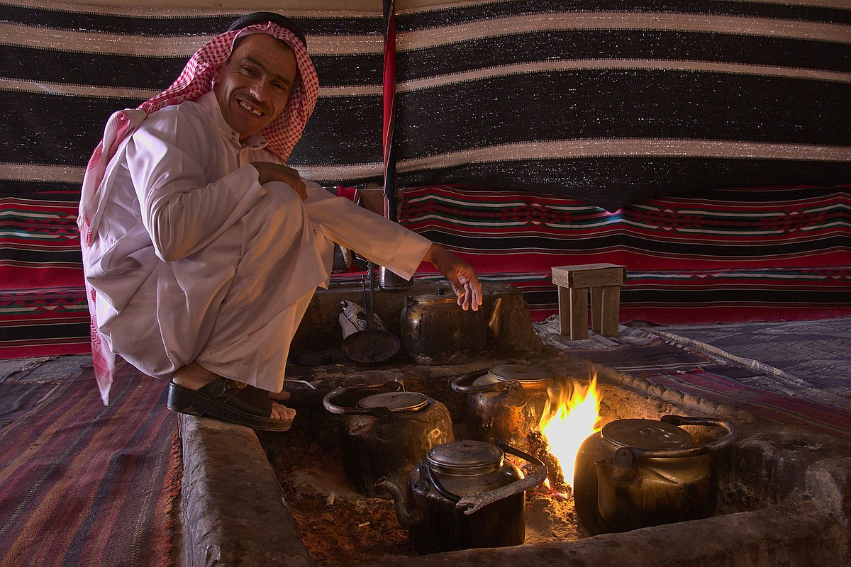 Preparing Bedouin tea next to the fire. Photo taken by Rob Oo, distributed under  CC BY 2.0  license.
