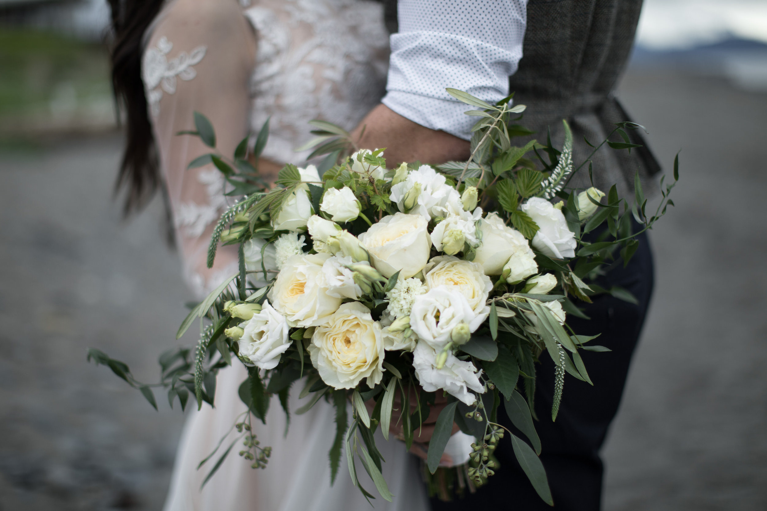 photo: Tyler Rye. This bouquet has already walked down the aisle, been thrown to the ladies, and done a little wading in the ocean. Tough stuff, right?!