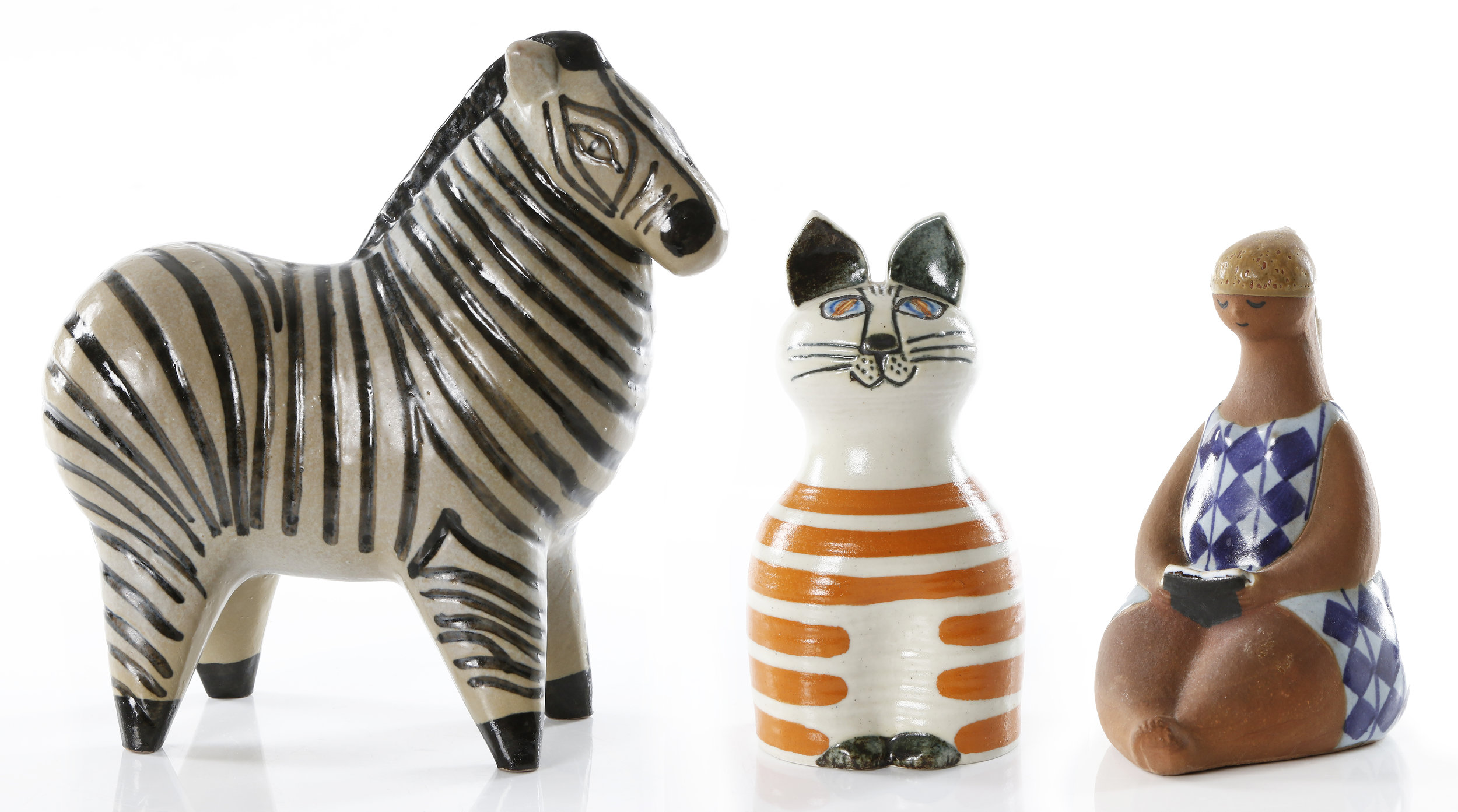 Lisa Larson's playful ceramic figures are always attractive at auction and are sought after by collectors all over the world.