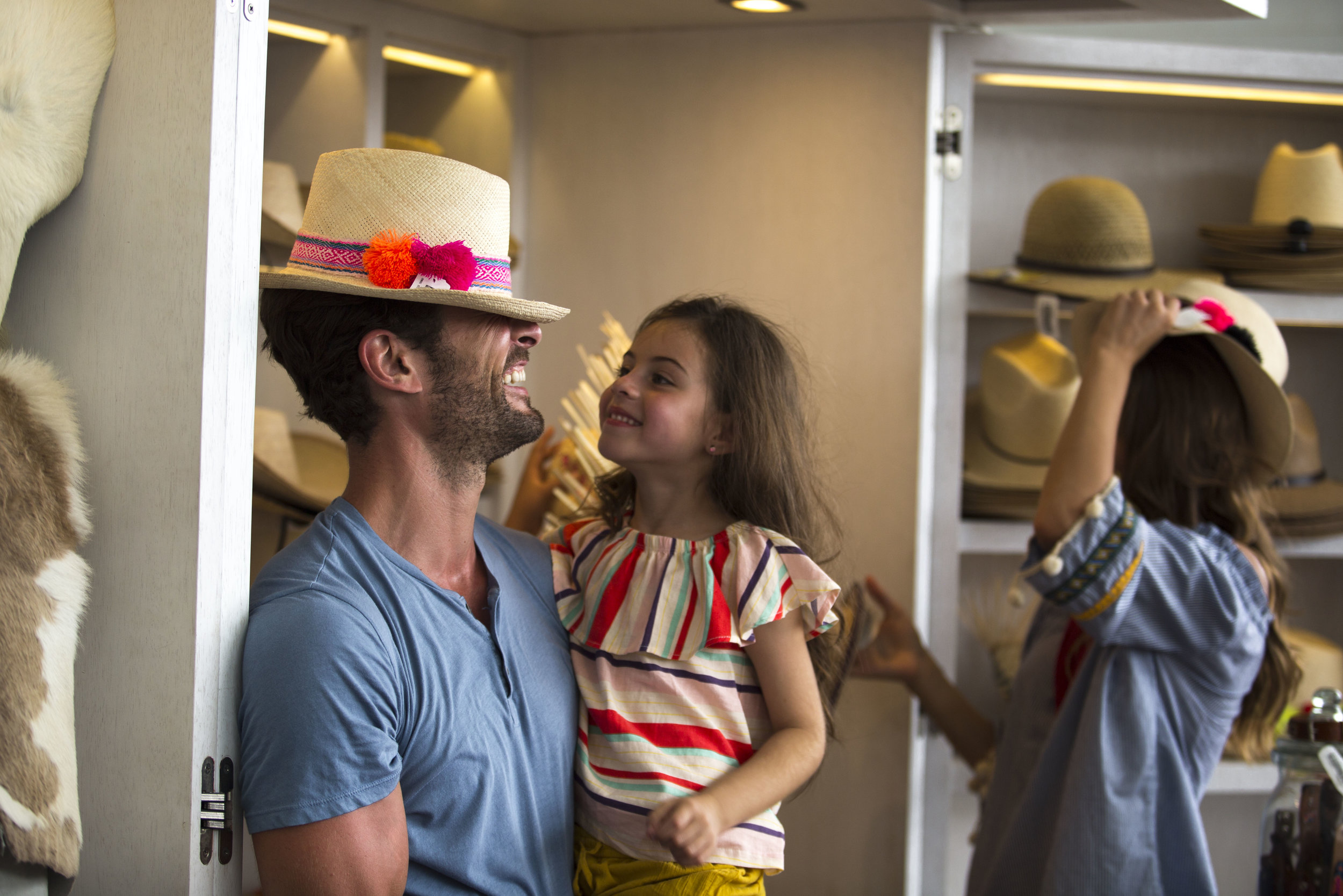 VID_NV_ElMercado_Dad_Girl_Hats.jpg