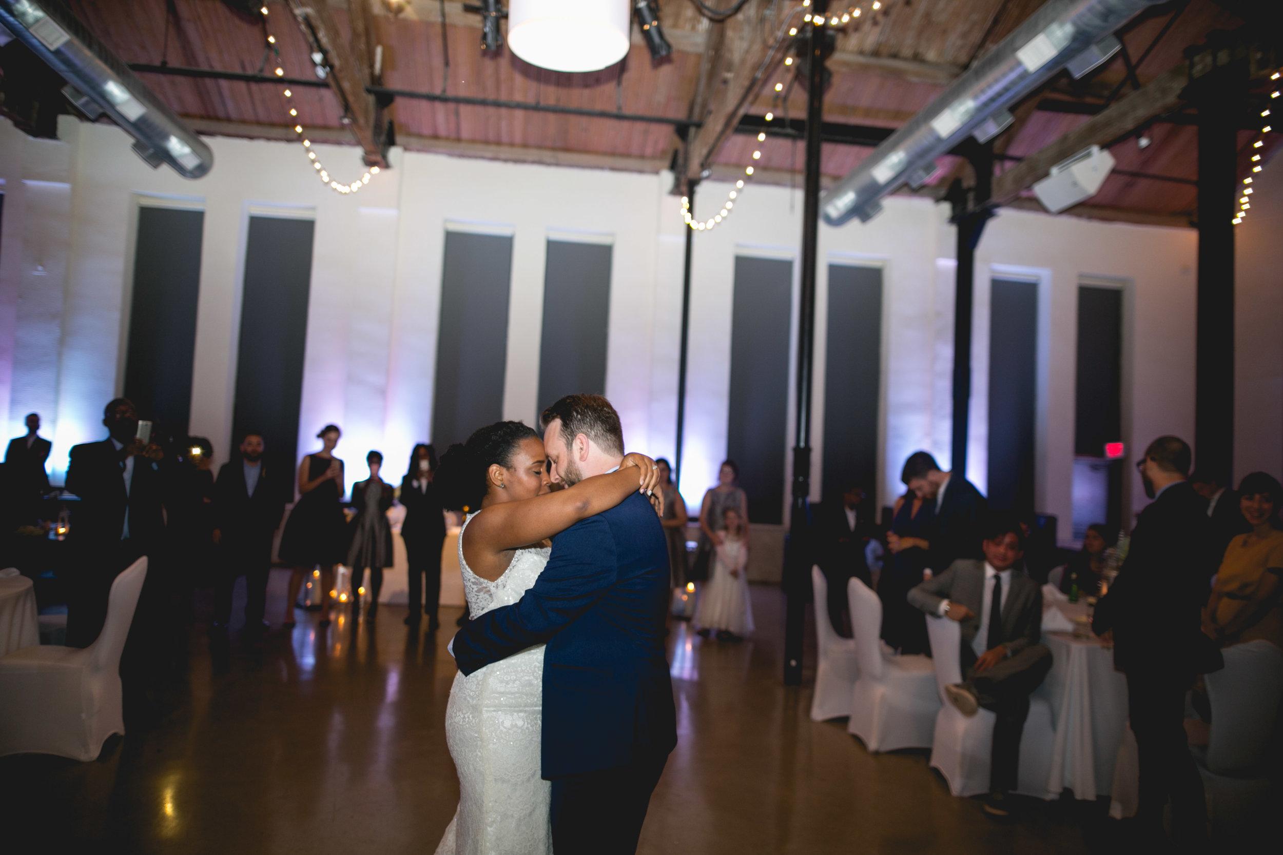 A Philadelphia Fishtown Skybox Wedding by Lesbian Photographer Swiger Photographer. Monet and Daniel - an industrial fall Philly Wedding