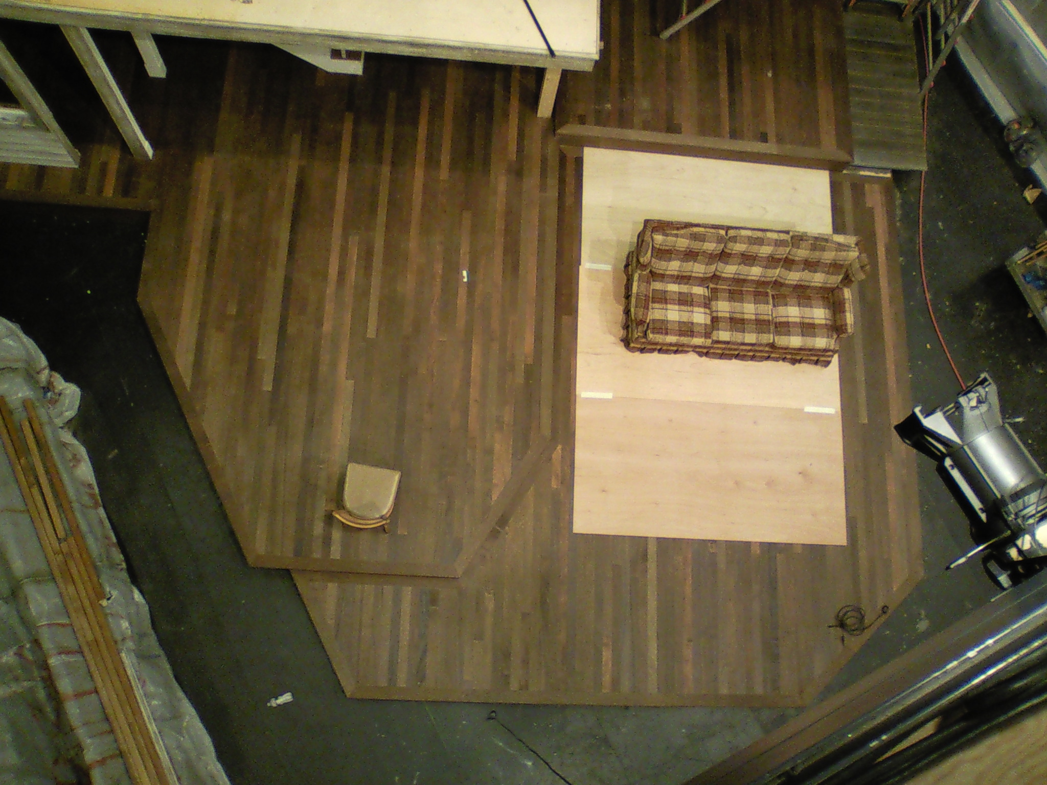 Aerial view of  August: Osage County  flooring made up of ripped sheets of stained lauan, makes for a good facsimile of hardwood flooring.