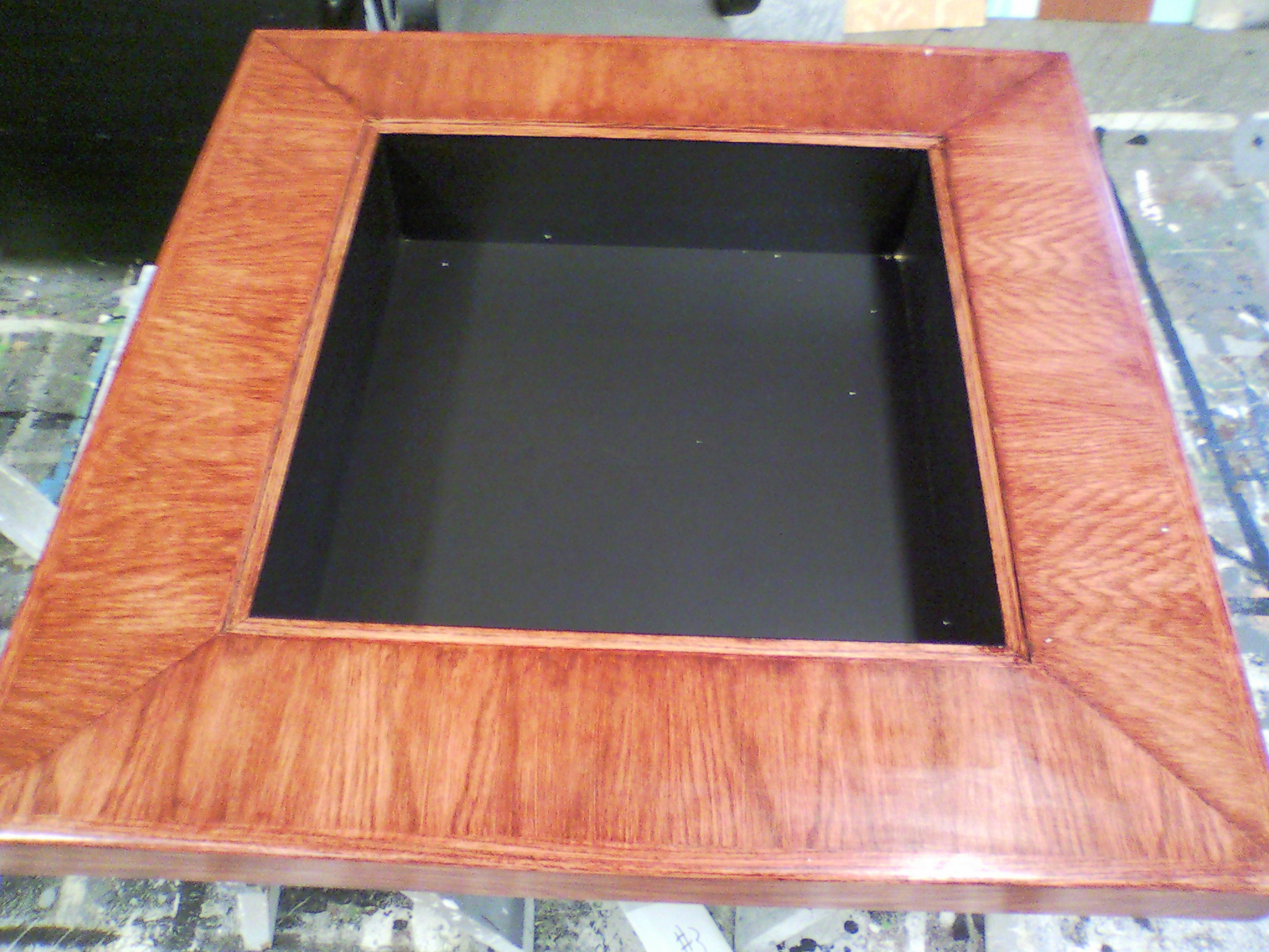Black box table made for displaying products below glass.
