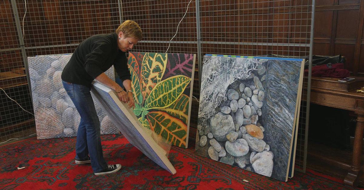 Local artist Julia Keates prepares her work for display.
