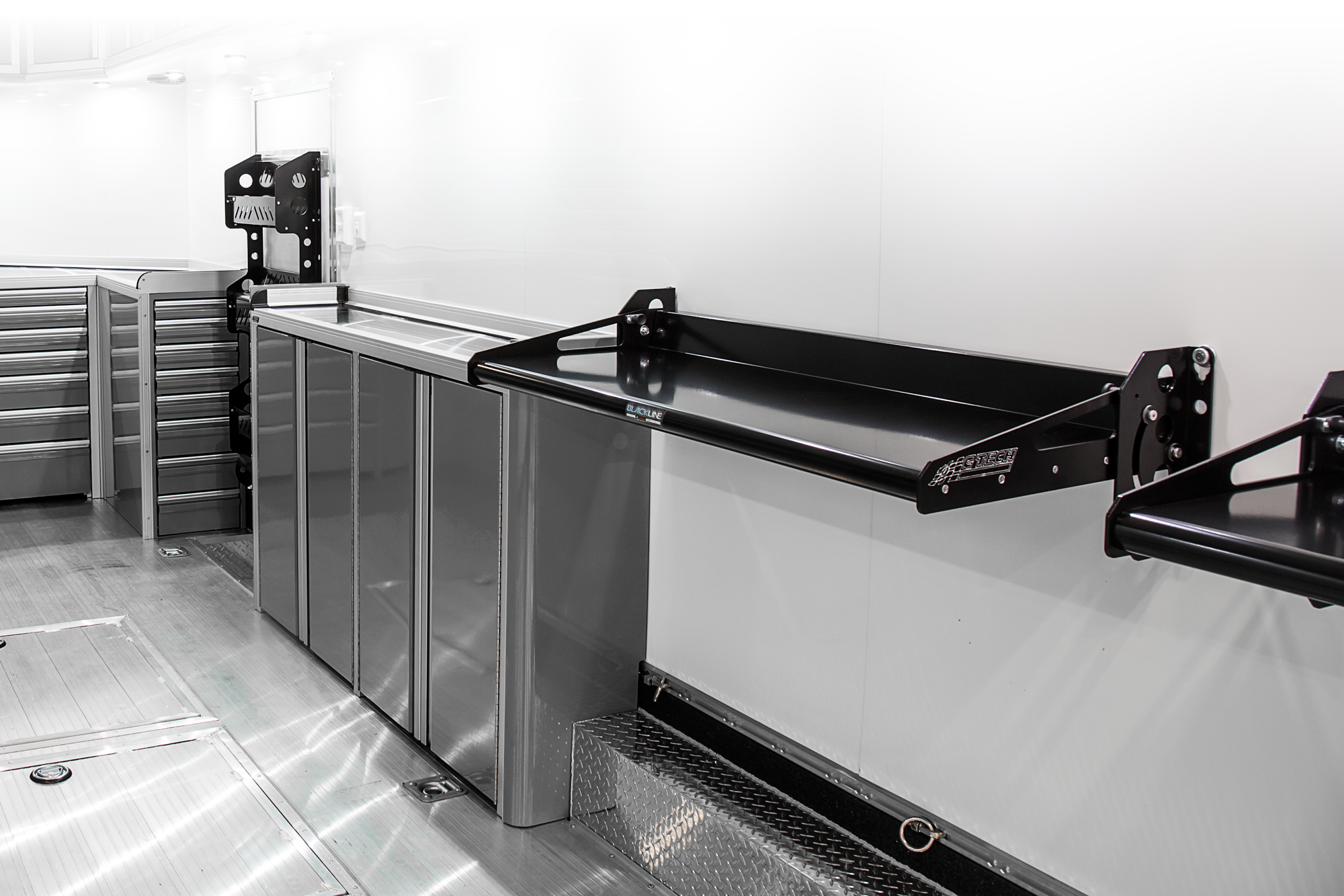 BlackLine Accessories: Lite Duty Fold Down Bench and Accessory Rack - Trailer application