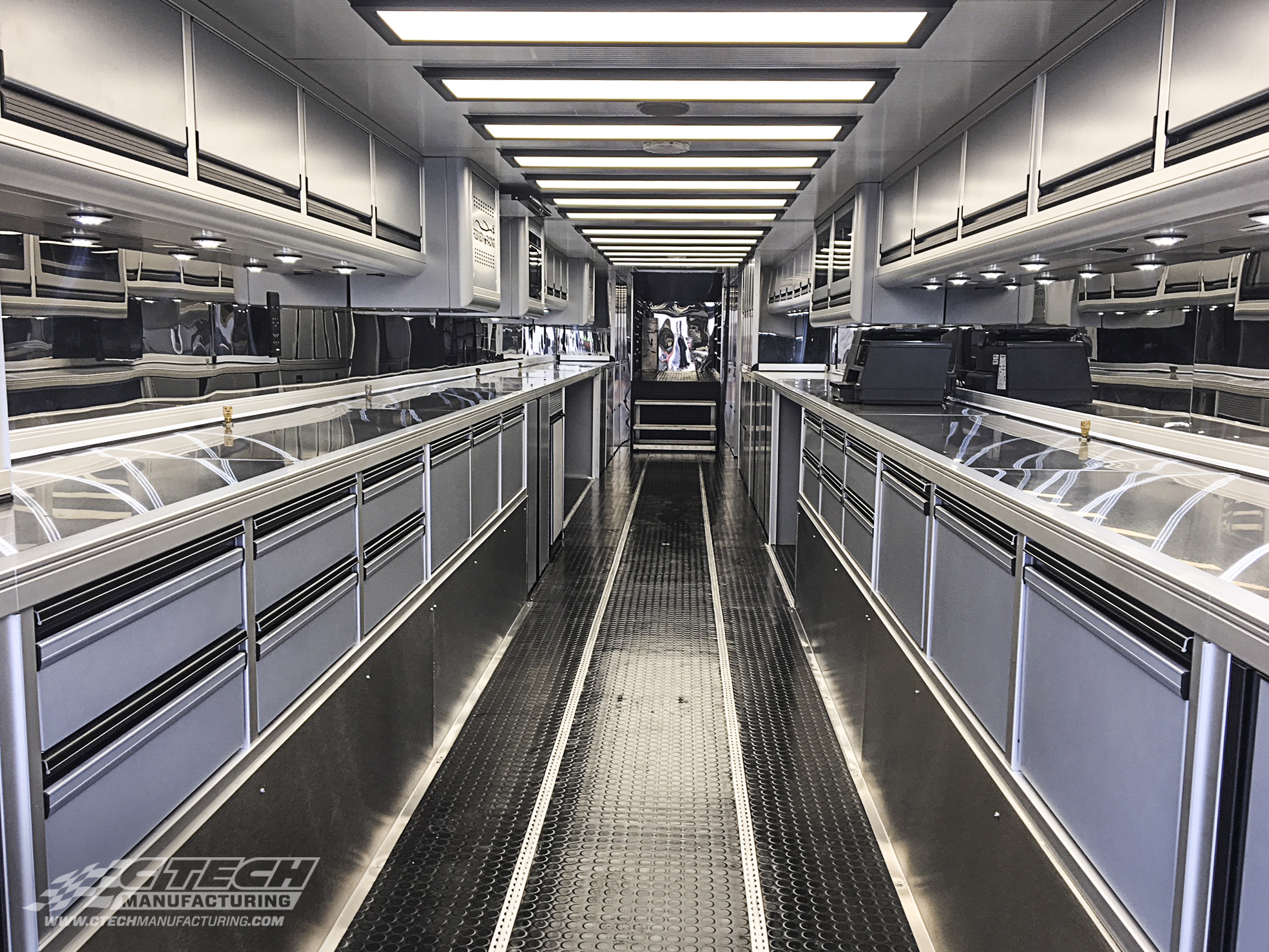 Motorsport trailer/transporters rely on innovative engineering and creative design to overcome space and weight constraints. The team at Turnkey Industries / Robinson Racing did just that with their latest hauler. BOM 42065