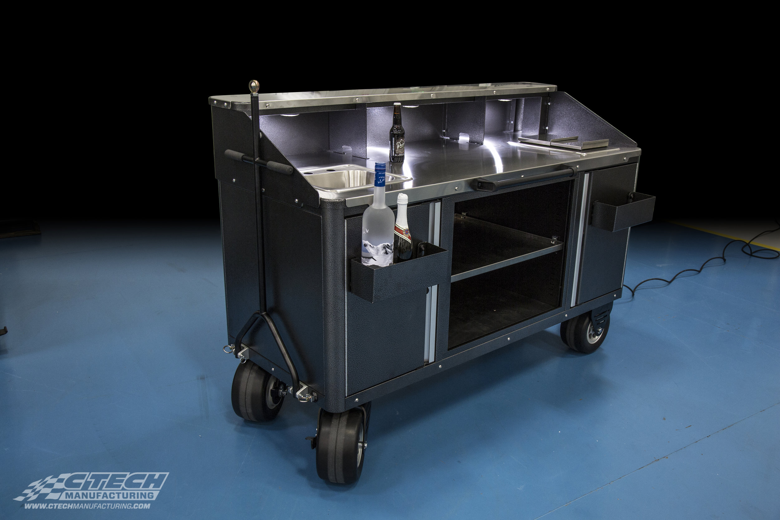 Need a drink? CTECH brings the bar to you with this Bar Cart equipped with all-terrain BadAss Caster wheels. Interior LED lighting is included, complete with all of the other amenities that a mobile bar can offer.