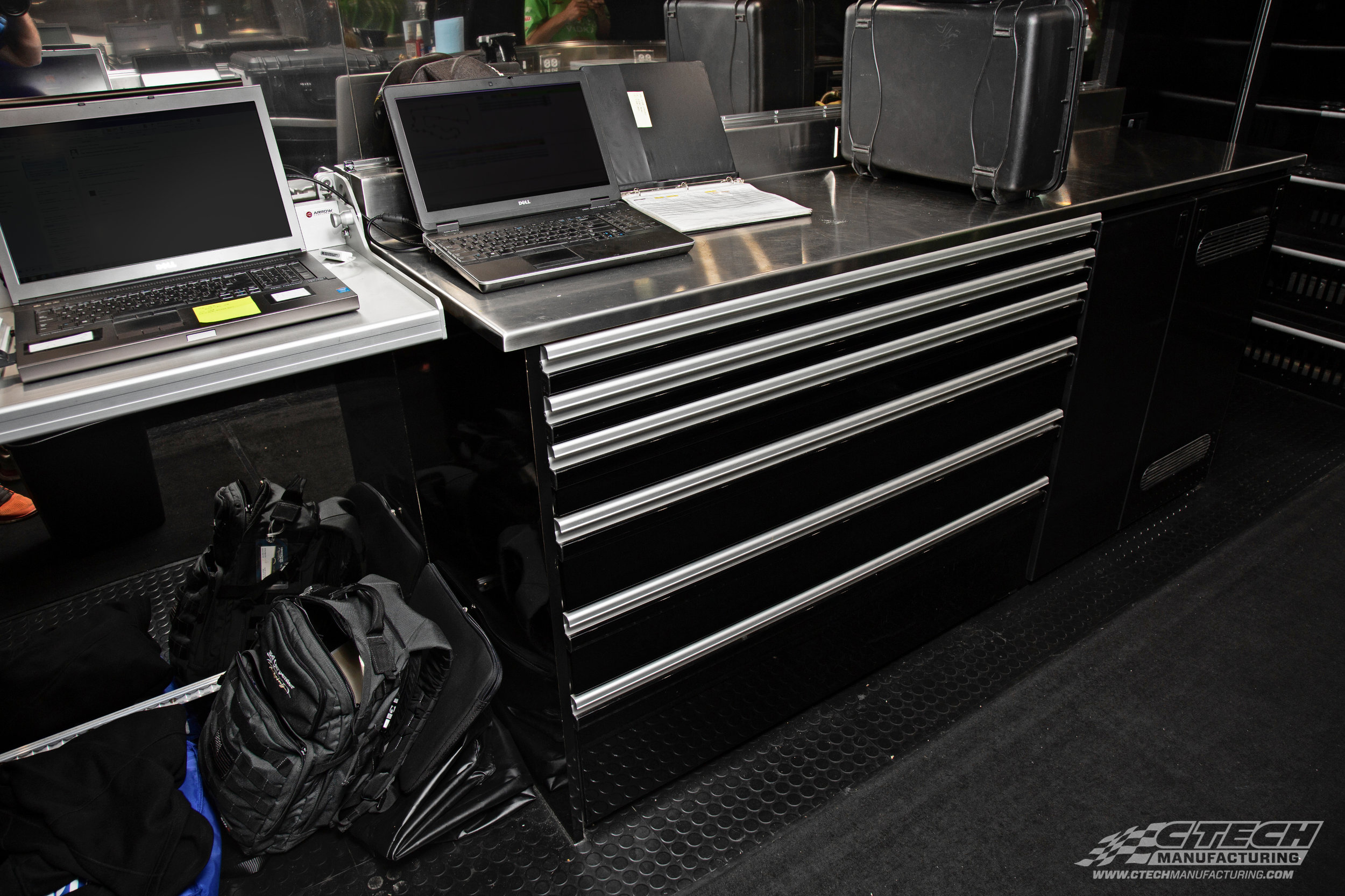 The team at Carpenter Racing get the most out of their transporter on the road and in the pits. With everything stowed and secure, they can use the countertops as a workspace instead of extra storage!