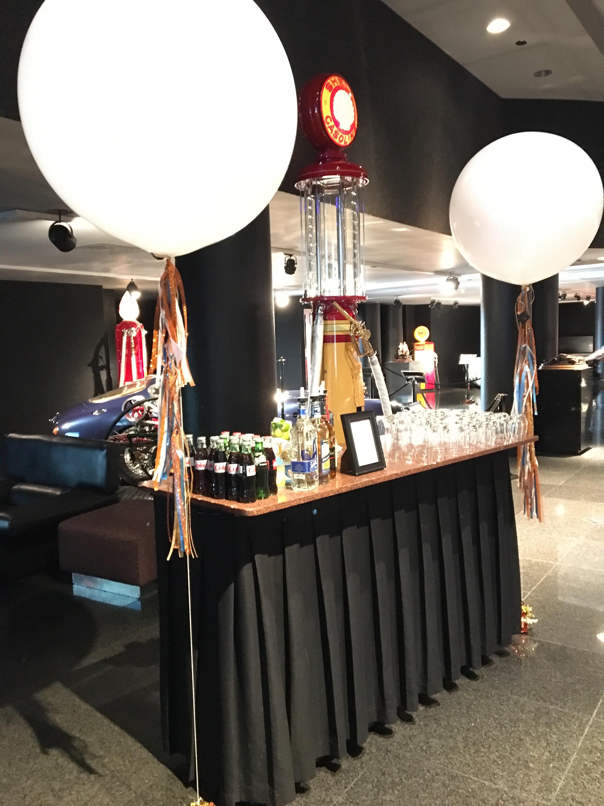 twin balloons flank the bar