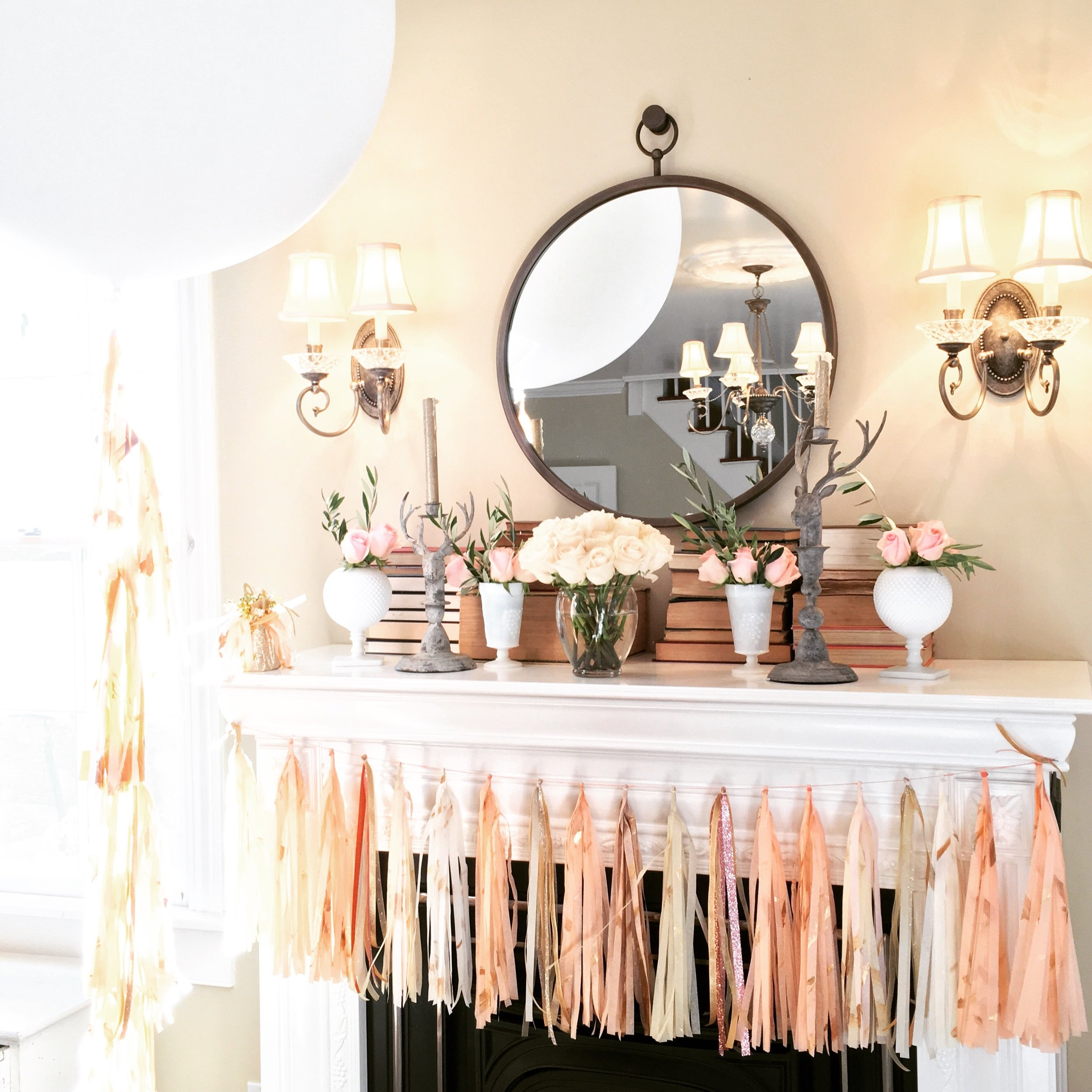 Hand painted garland is trending in home decor and party styling for Lifted Balloons' clients this year. - Tissue tassels hand painted with gold metallics, or mixed metallics, seem to be flying out of the studio!