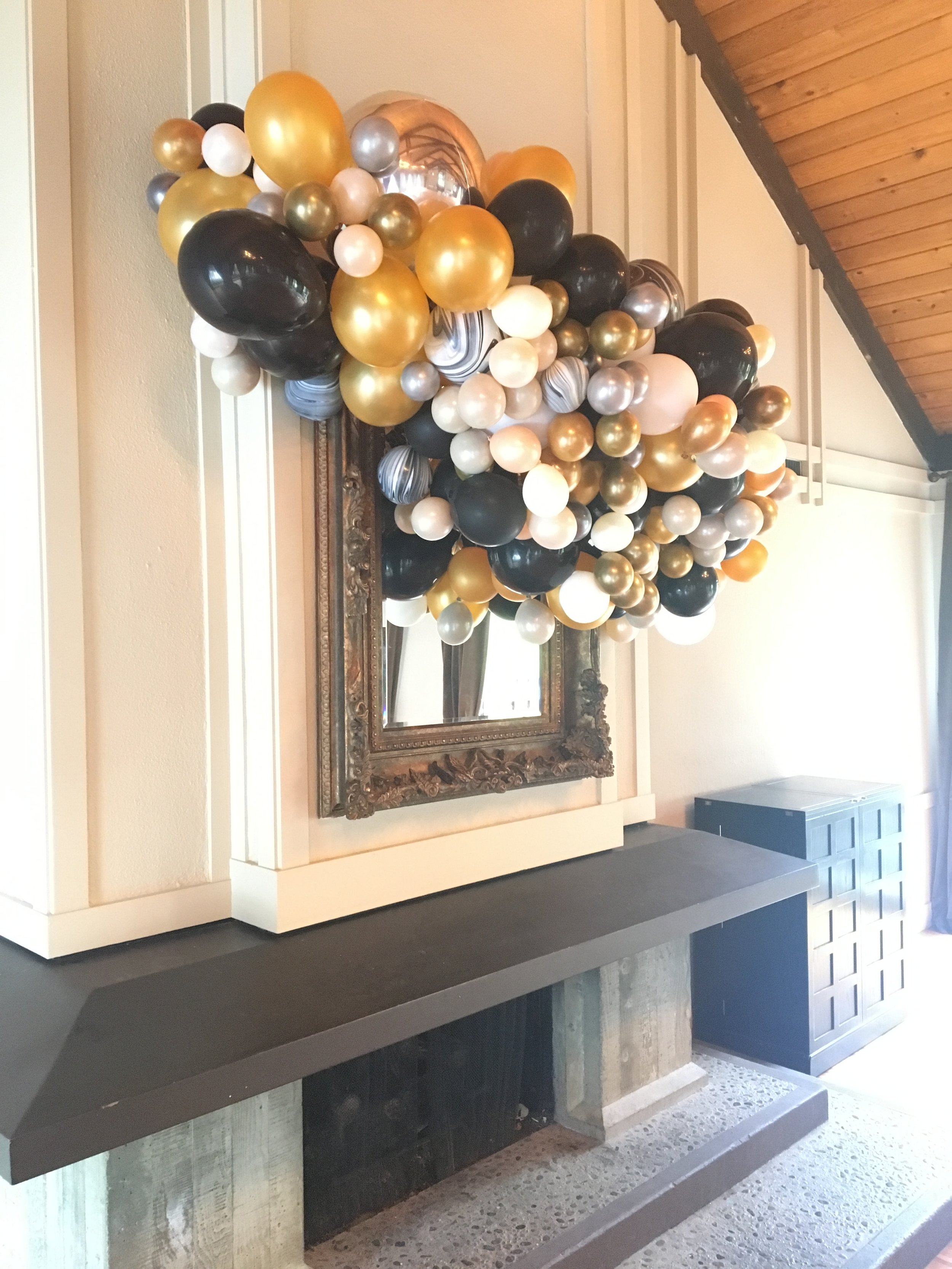 Balloon Bursts and Balloon Waterfalls- - are the best party idea for visual impact that is unforgettable! Attendees of this event still talk about this balloon installation months after the ball!