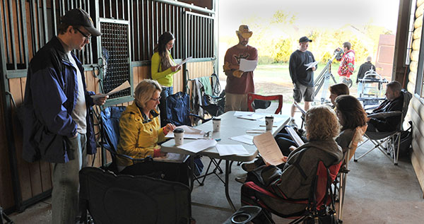 Screenwriters Robert Palmer and Lori Kay Allred guide the cast and crew through a table read at the Hanlon Family Ranch in Elizabeth, Colorado. (July 2014)