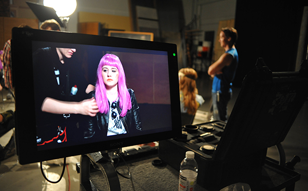 Actor Sydney Ackman goes through final-looks while on set at the Comcast Digital Media Center in Centennial, Colorado (August 2013)