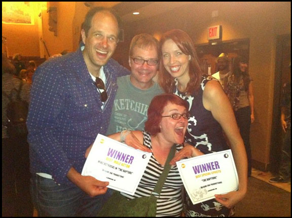"""(Clockwise) """"Best Actor"""" winner Mike Ostroski with screenwriter Robert Palmer, executive producer Rachel Hroncich and actor Summer Olsson at the Kimo Theatre in Albuquerque, NM. (July 2011)"""