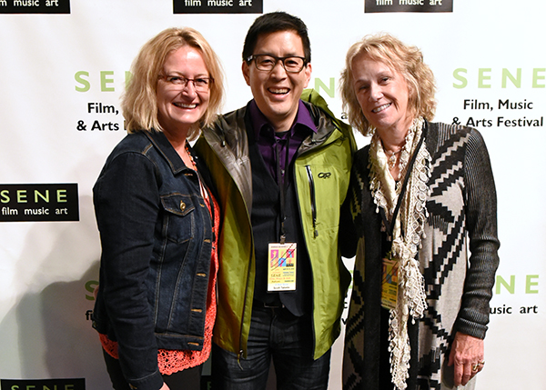 BS Filmworks director Lori Kay Allred and producer Scott Takeda walk the red carpet with actor Catherine McGuire at the closing ceremonies of the SENE Film Festival at the Columbus Theatre in Providence, Rhode Island. (April 2015)