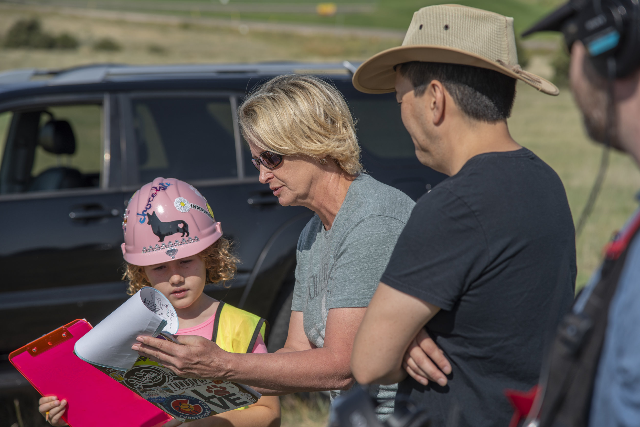 Nev Scharrel and director Lori Kay Allred go over the script during a recent shoot.