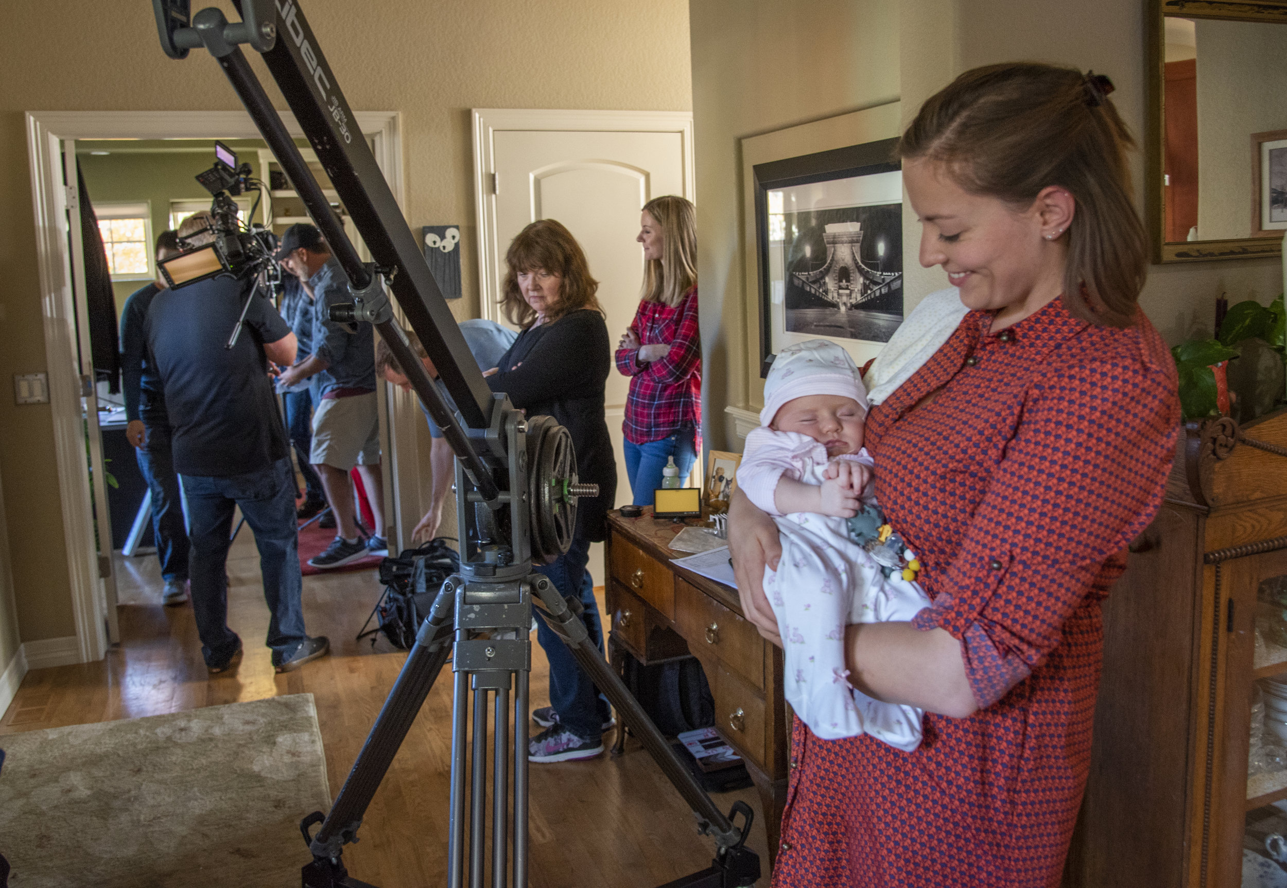 Lead actor Dani Payne (Kate Novak) hangs out with infant actor Avery Vandenberg (Chloe Novak) as the crew adjusts for a camera move.